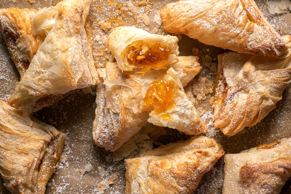 Mango puff pastries on parchment paper