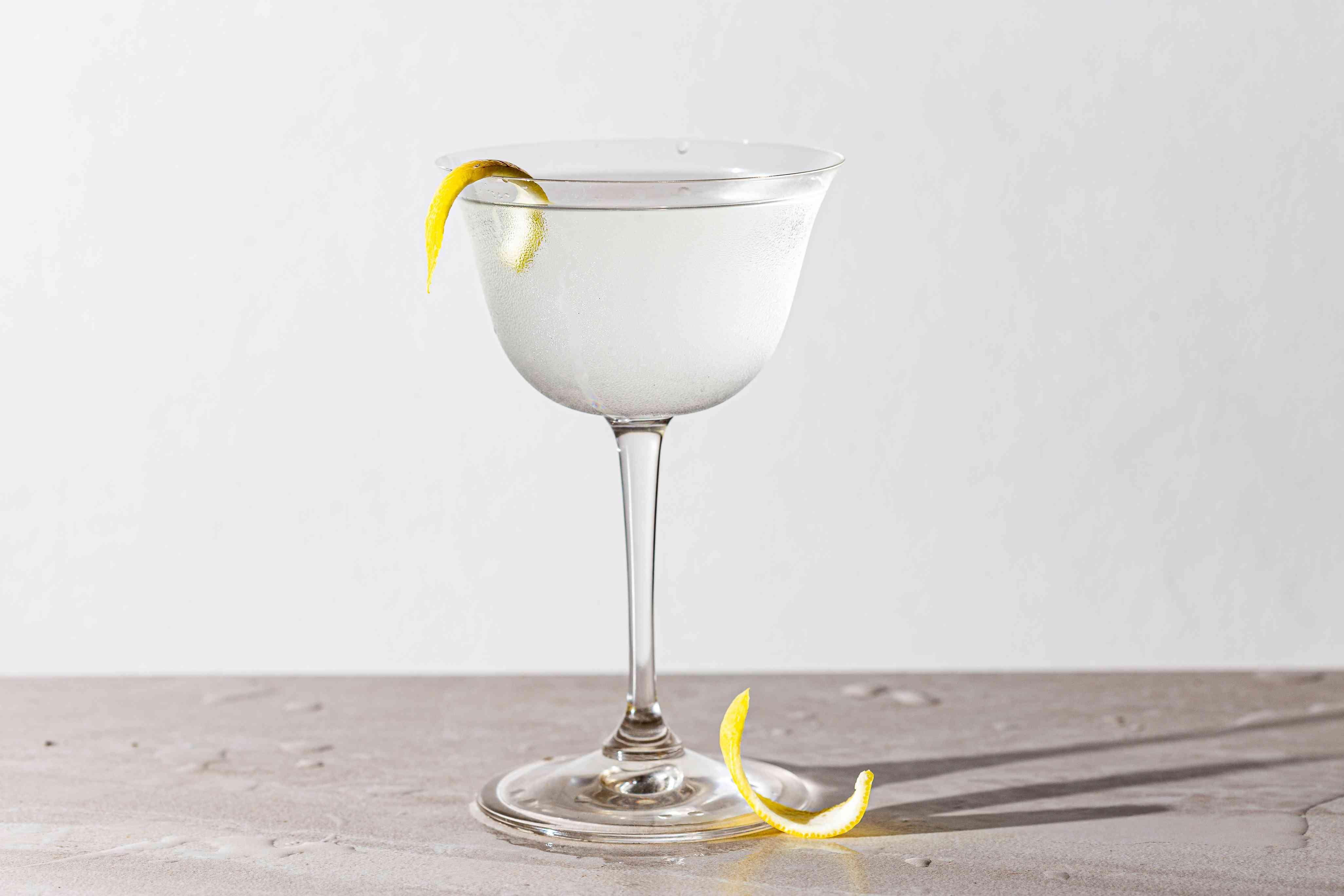Vodka martini in a glass with lemon peel