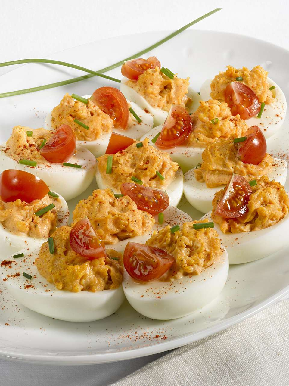 Delicious deviled eggs with tuna and tomato