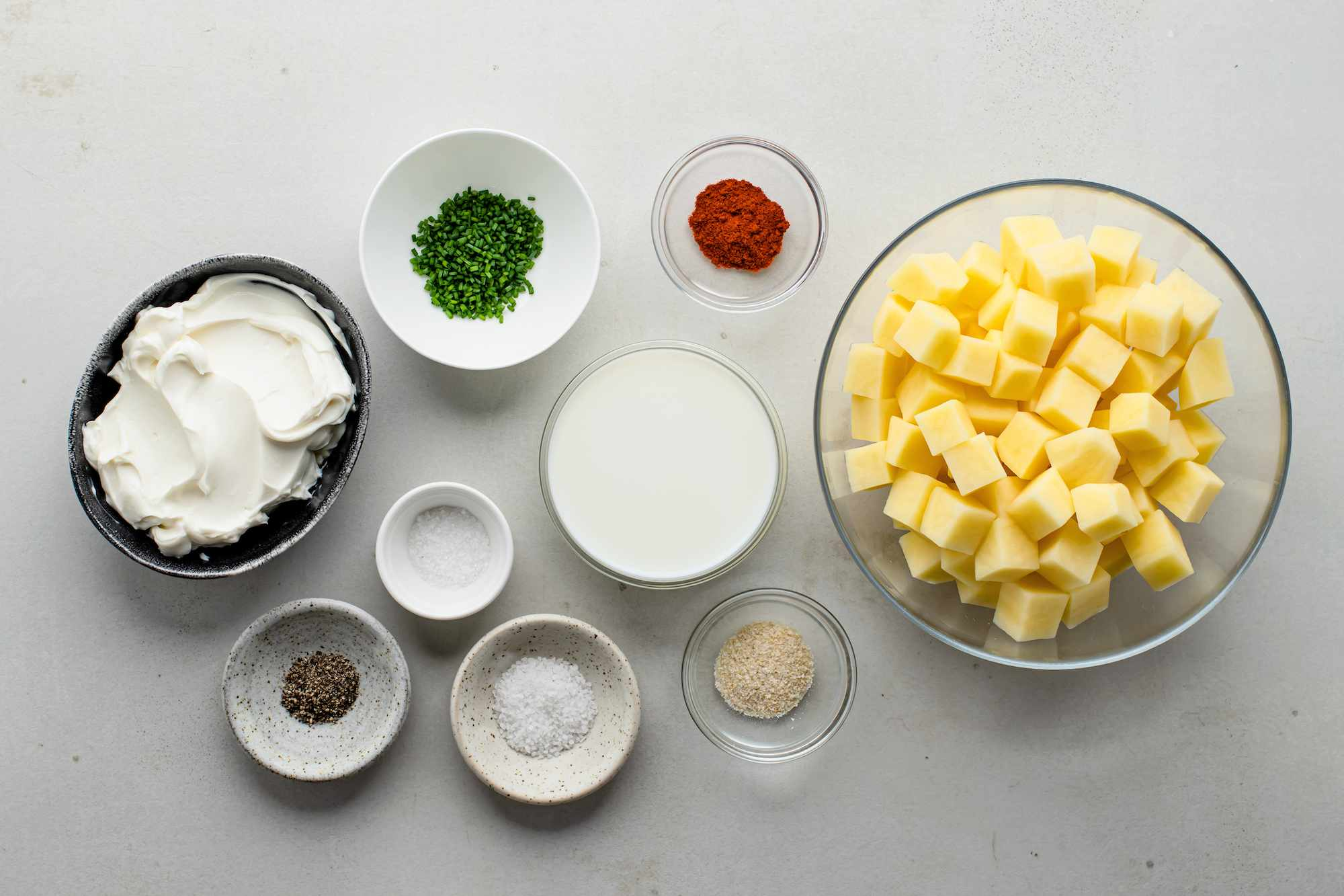 Ingredients for easy potato casserole with cream cheese and chives