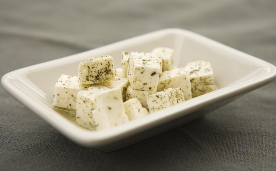 Feta cheese cubes sprinkled in olive oil and herbs