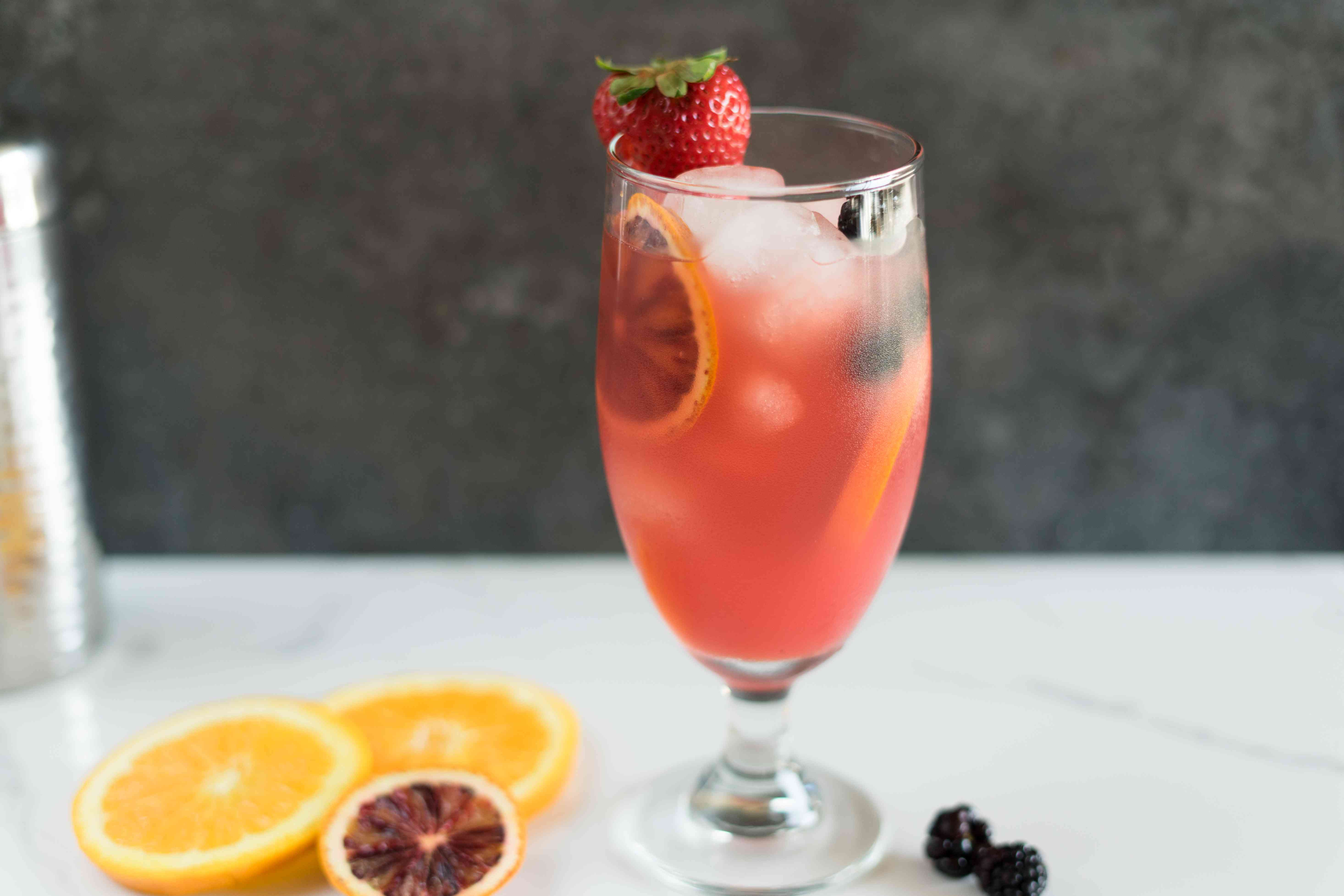 Rum runner with ice and garnished with fruit