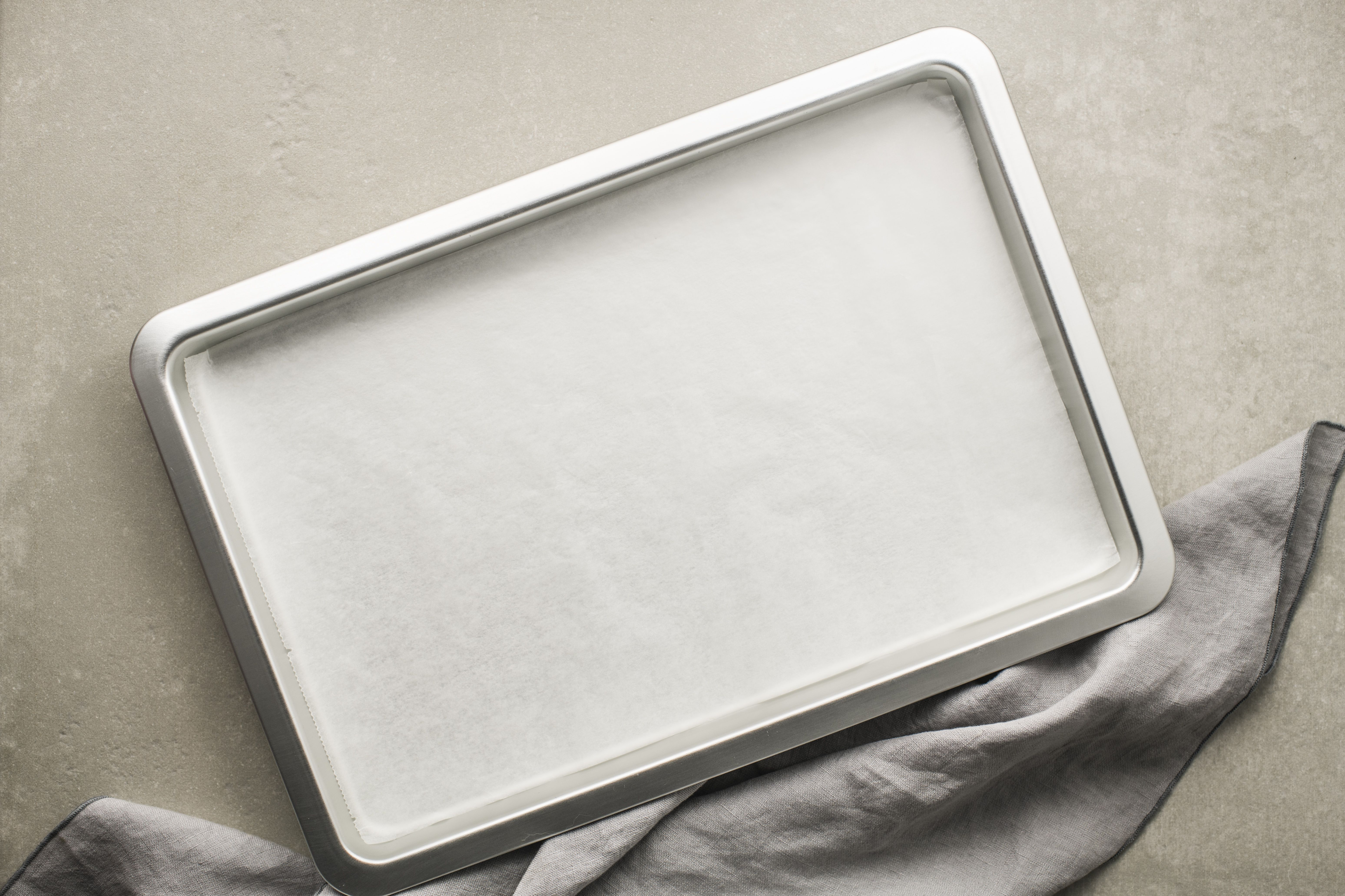 Line baking tray with parchment paper