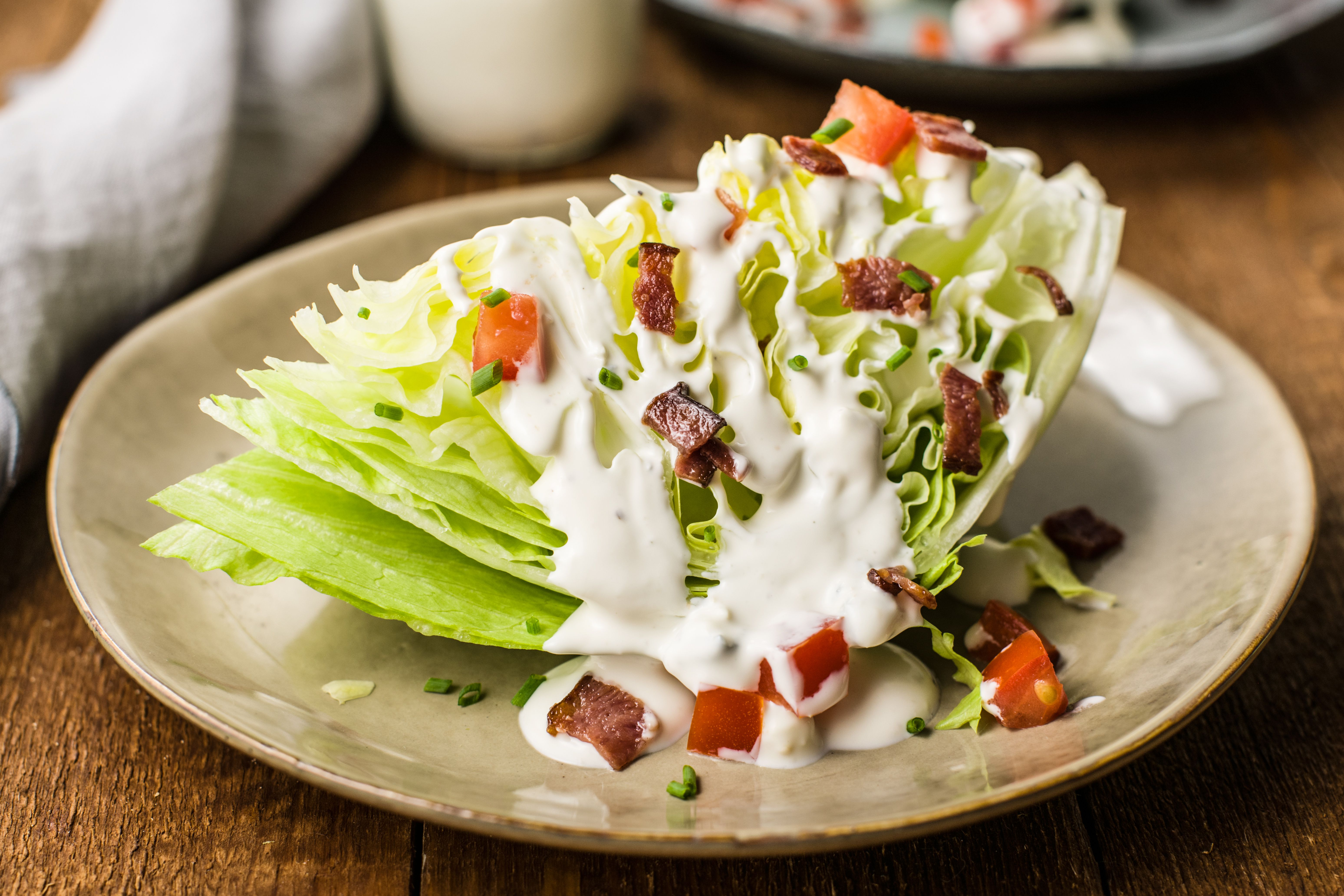 Blue cheese dressing over a wedge of lettuce