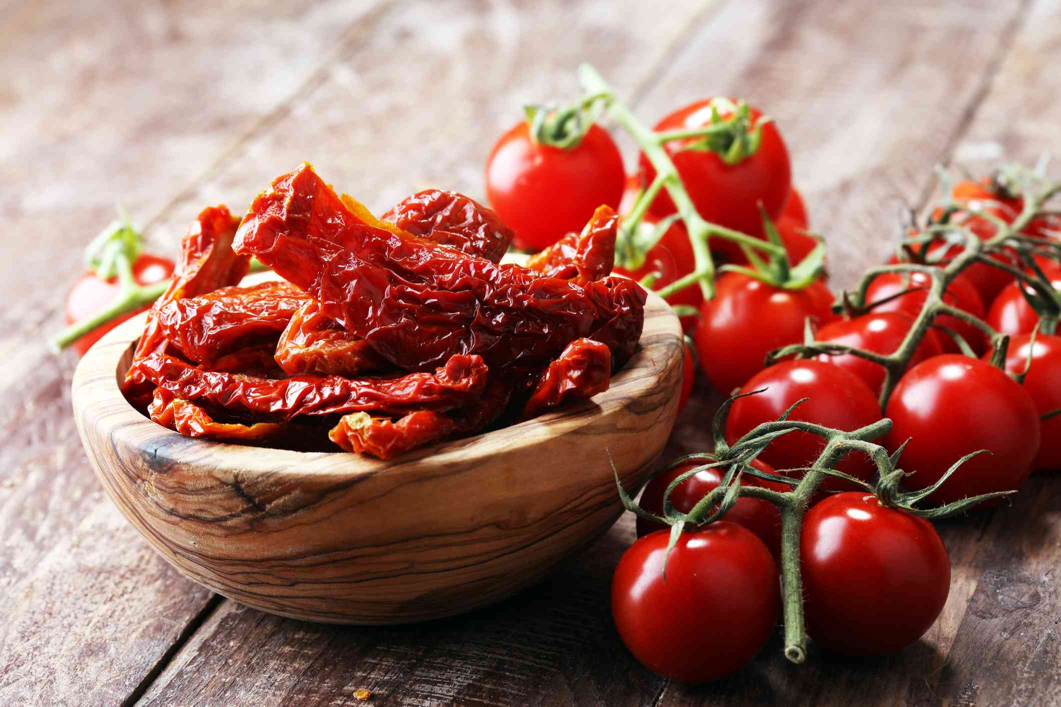 Sun-dried tomatoes and tomatoes on the vine