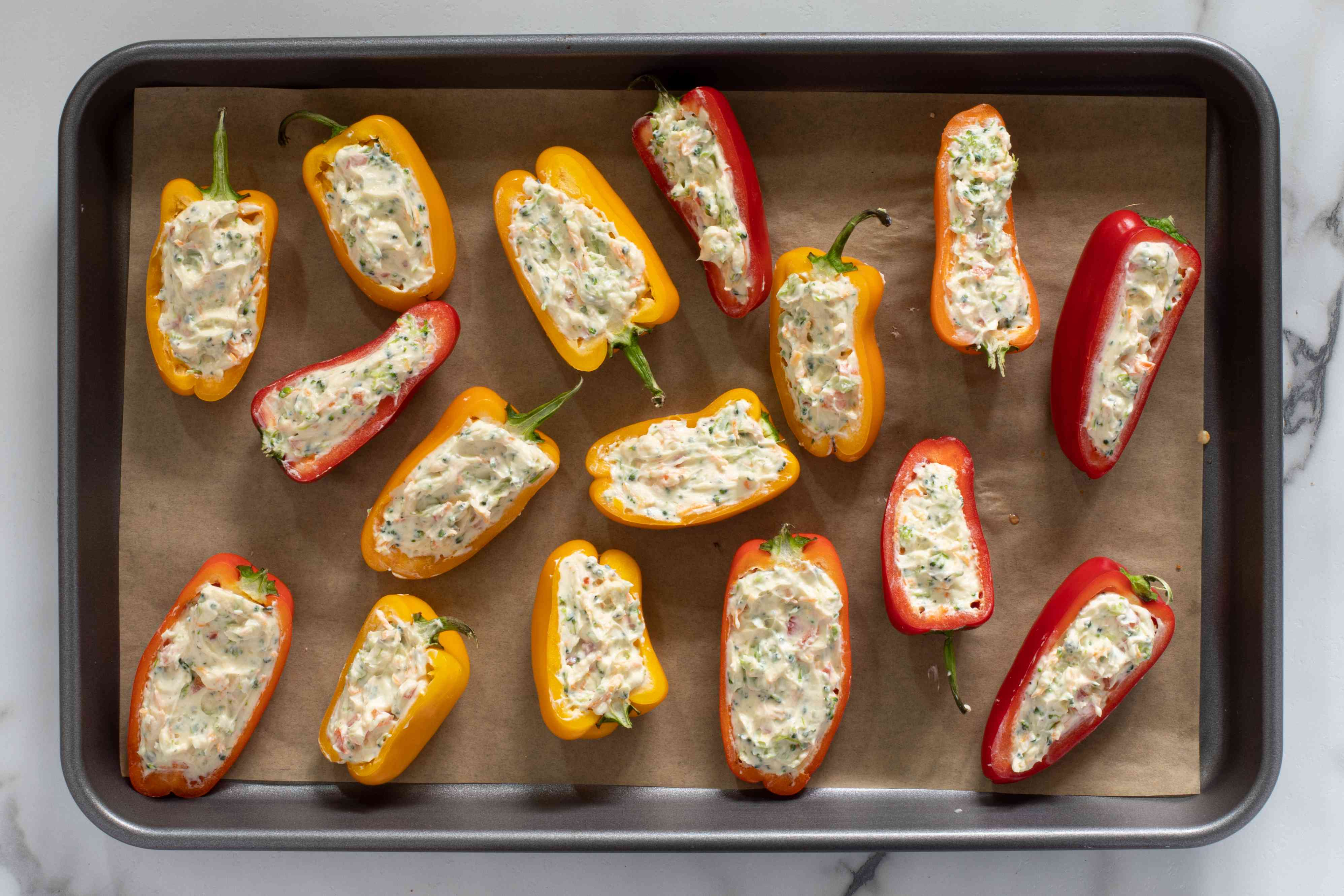 mini peppers with stuffing ready to bake