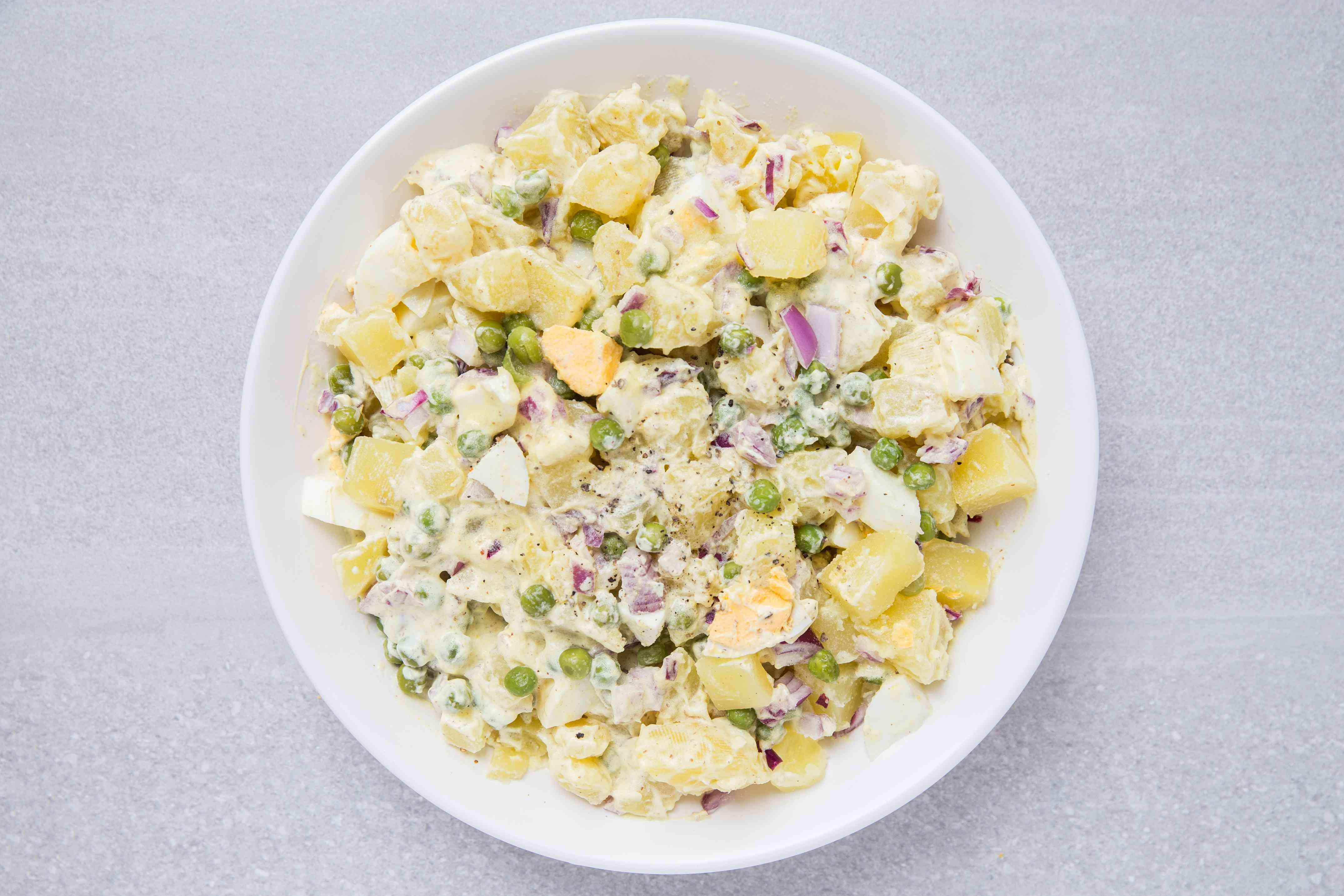 Potato Salad With Eggs and Peas in a bowl