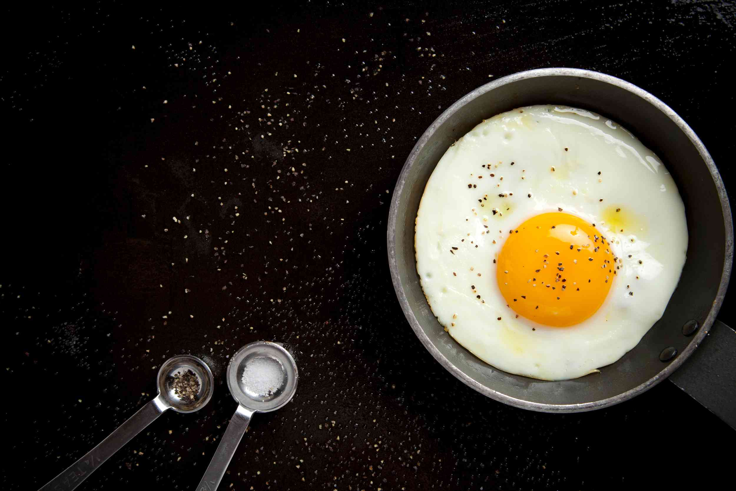 An egg with salt and pepper