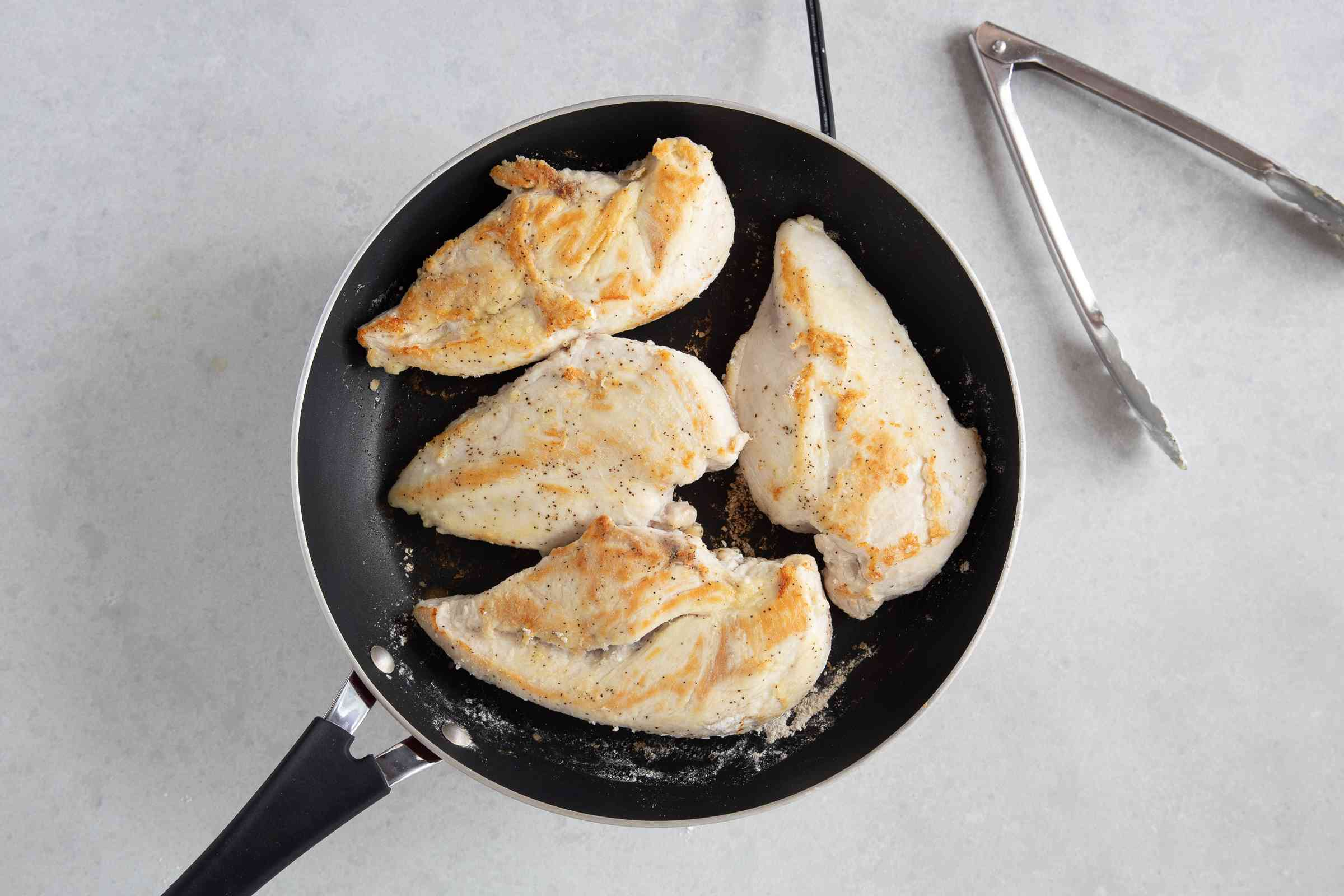 chicken cooking in a pan
