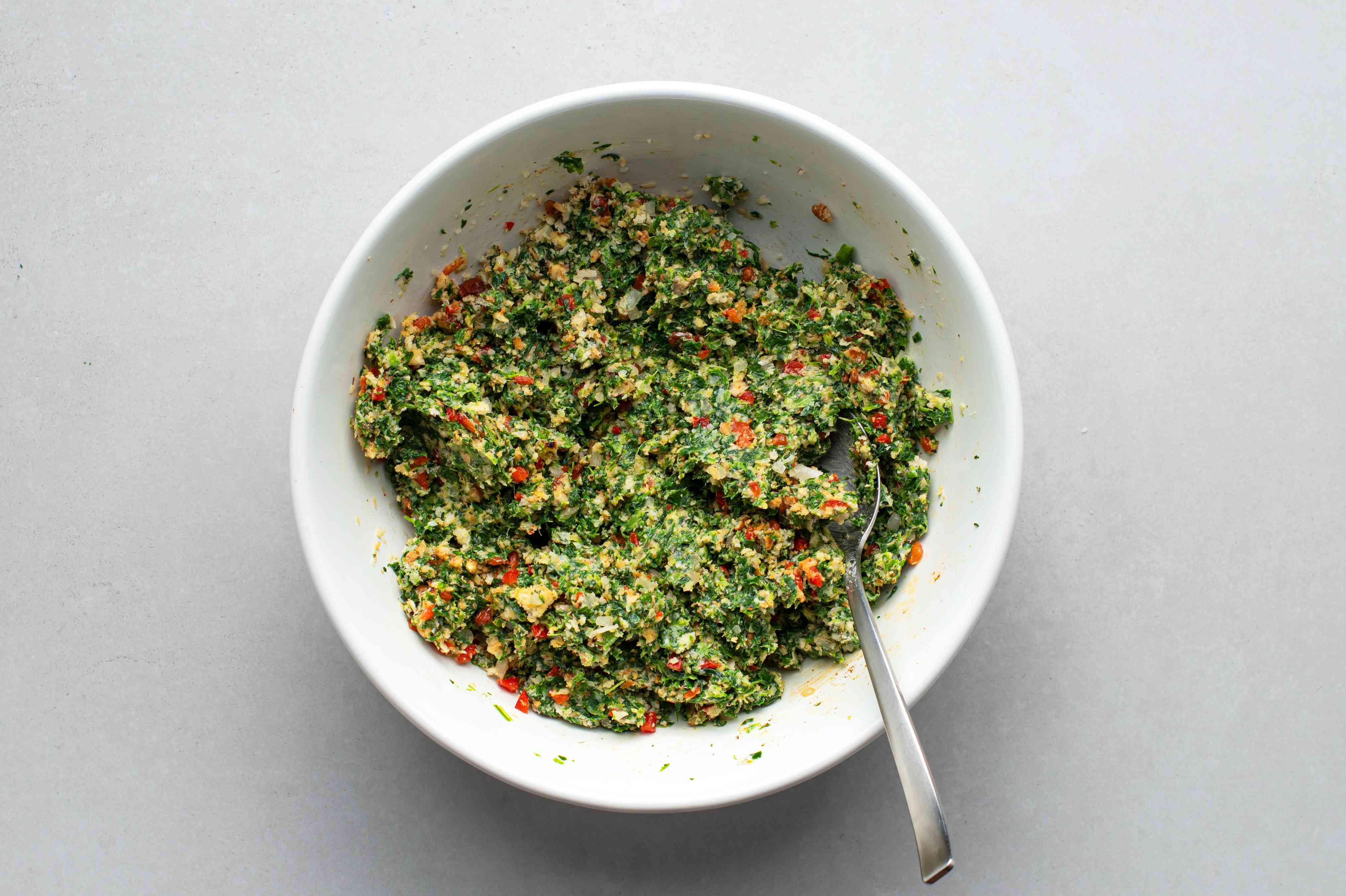 stuffing crumbs, Parmesan cheese, and minced onions combined with spinach and butter