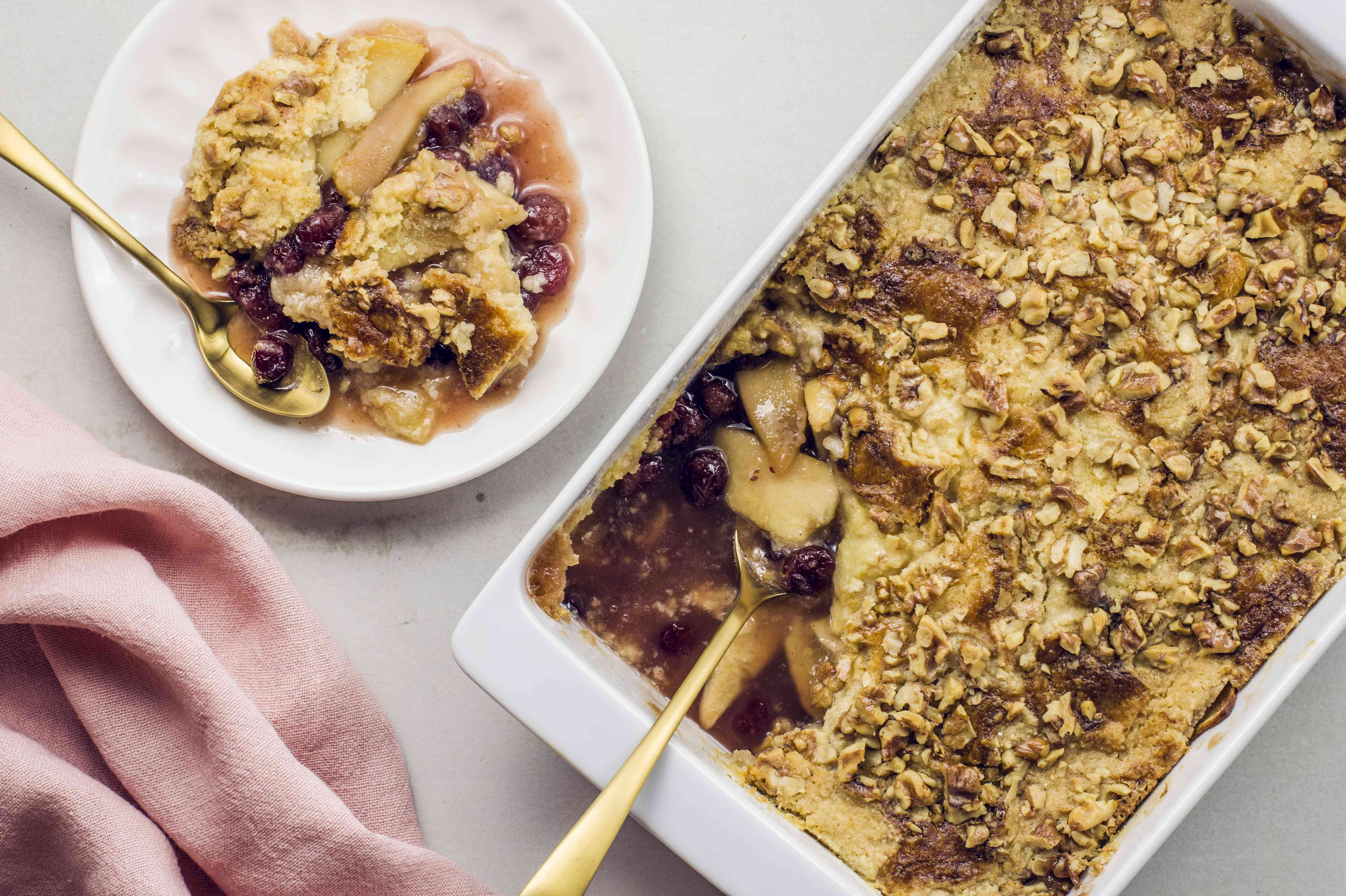 Christmas dump cake in a baking dish and on a plate with a spoon