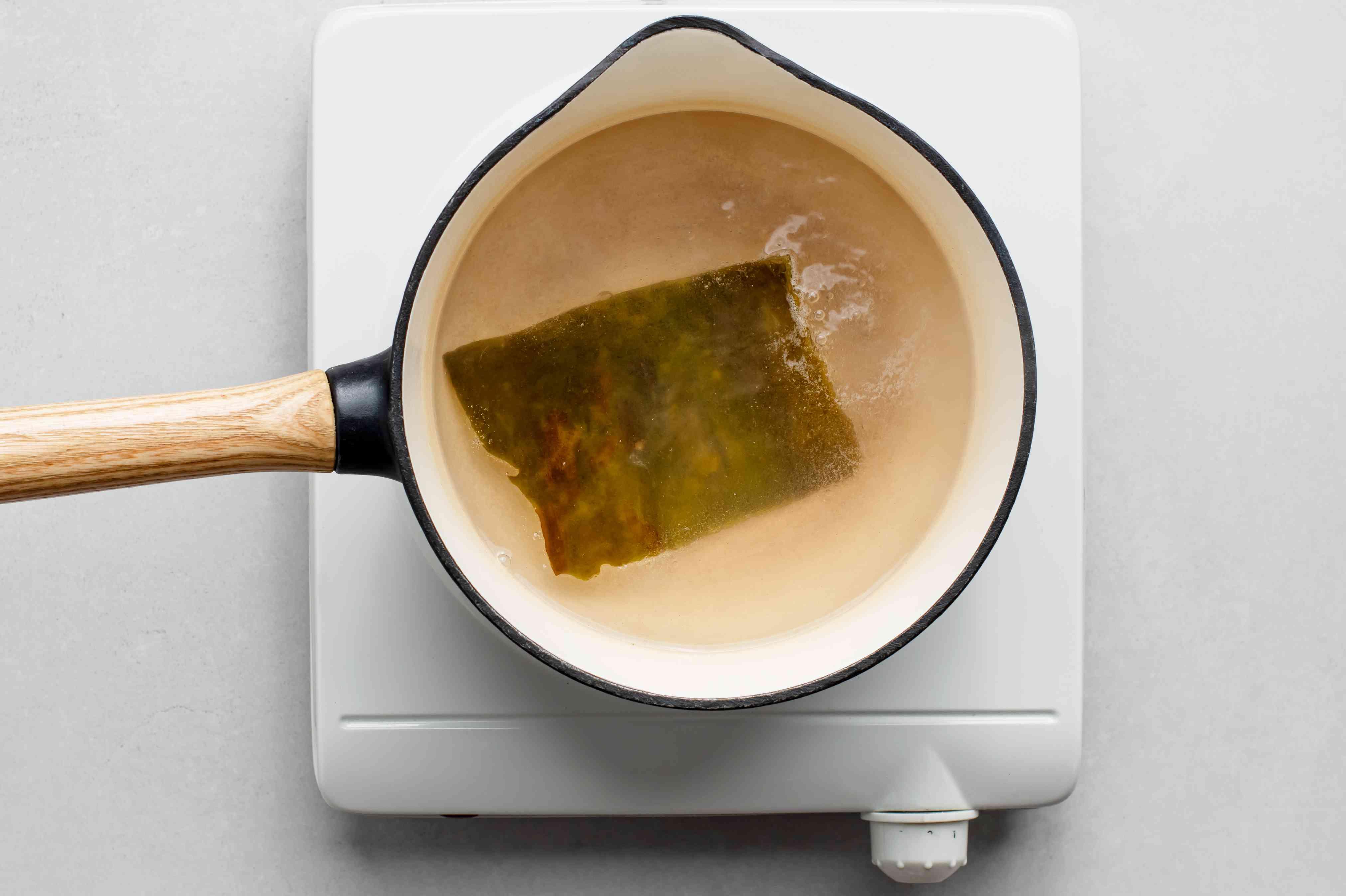 Water in a small saucepan with kombu