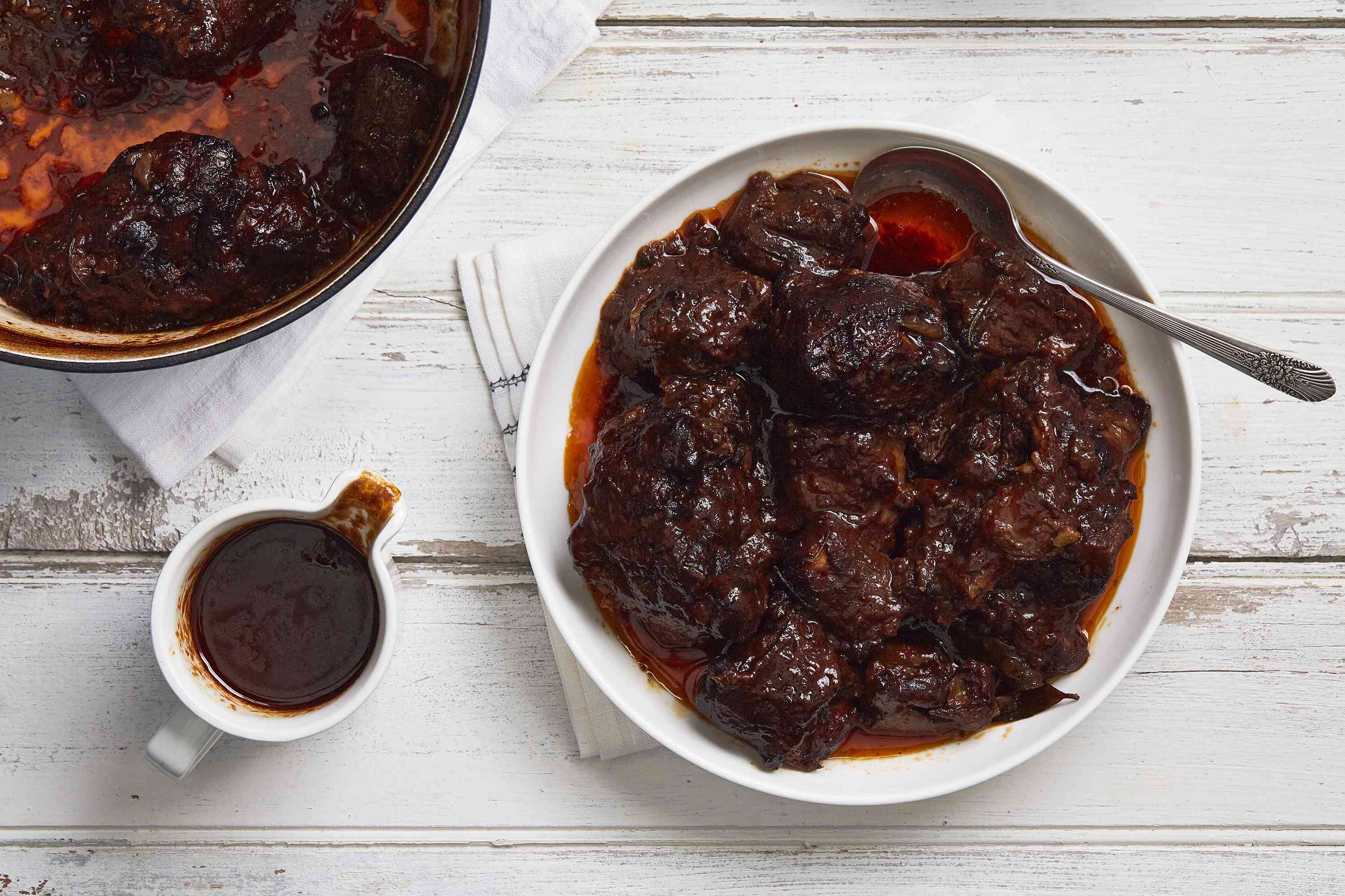 Braised oxtail on a white plate