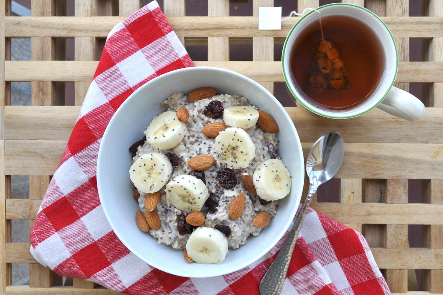 Overnight chia seed oatmeal topped with toasted almonds and sliced banana