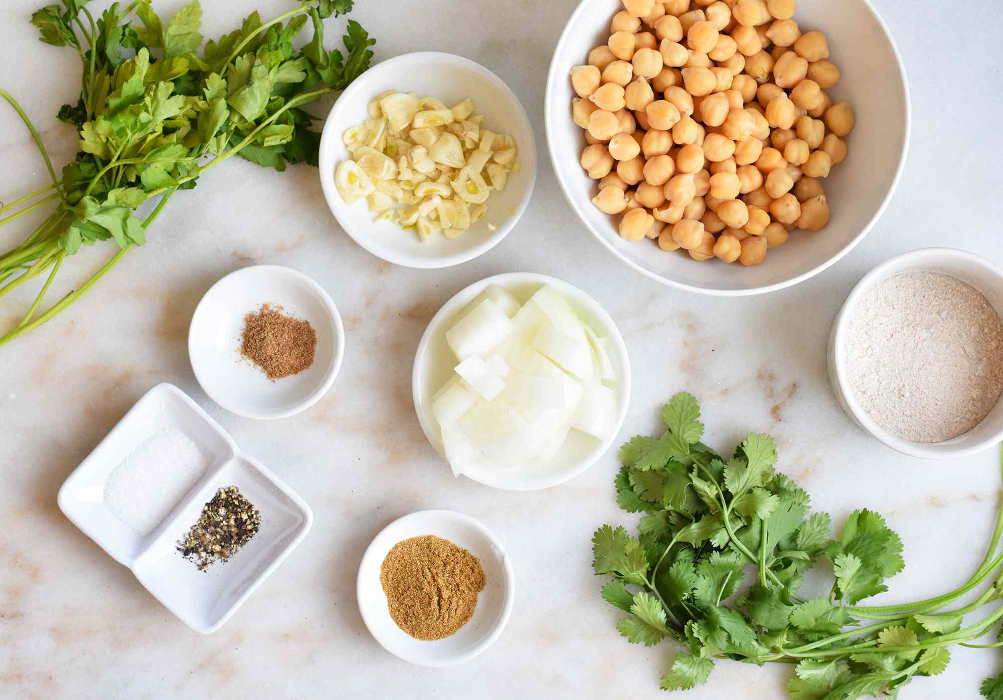 ingredients for air fryer falafel on a marble board