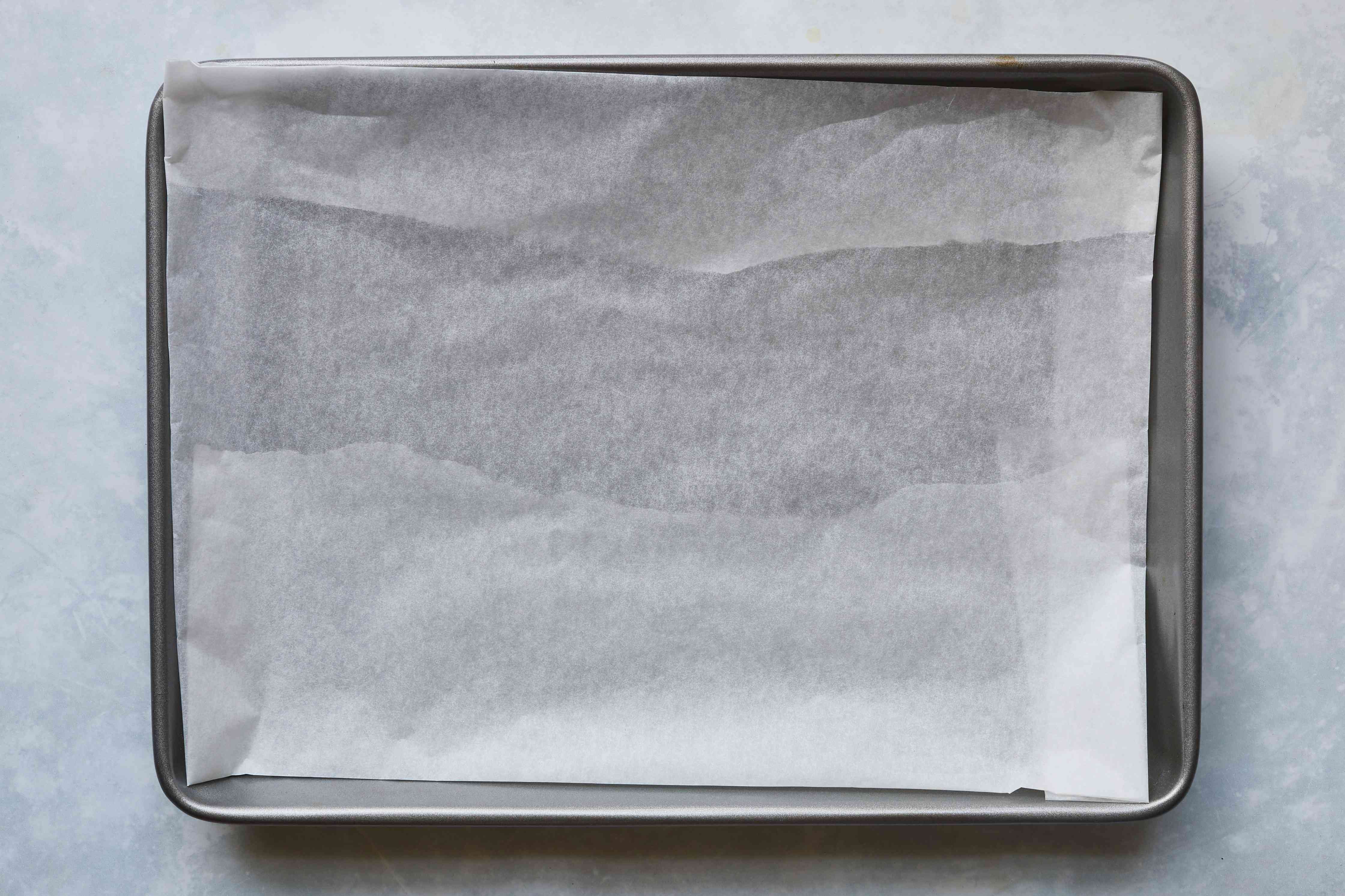 parchment paper on top of a baking sheet