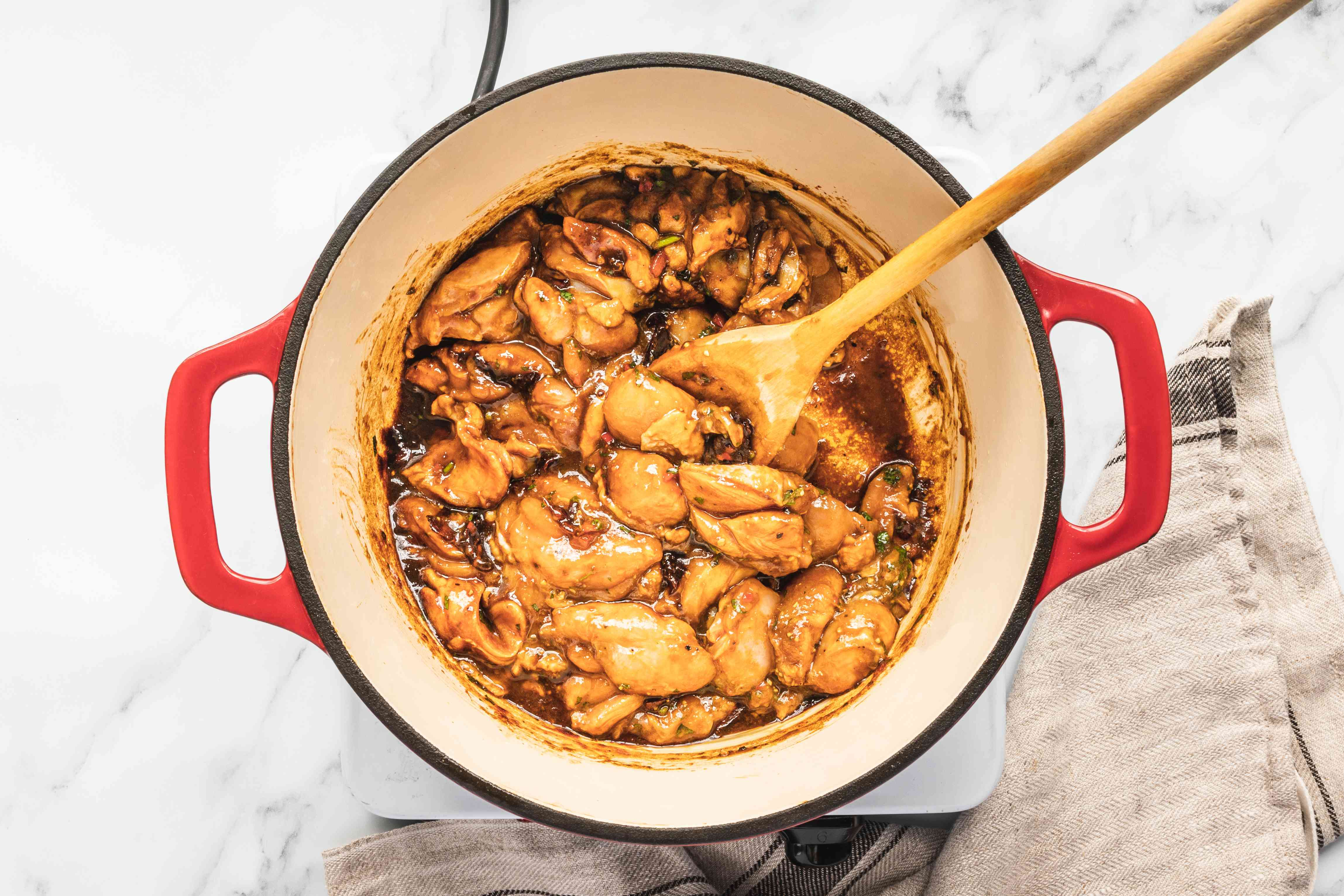 Stir to mix chicken with burnt sugar