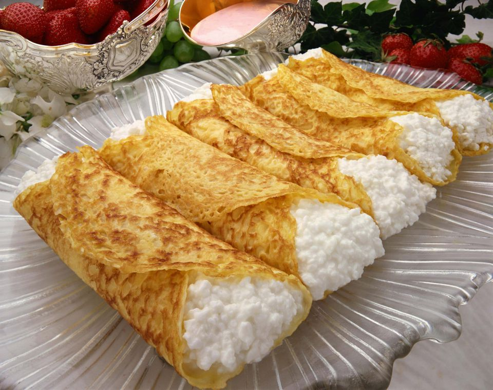 Close up of cottage cheese blintzes on a plate.