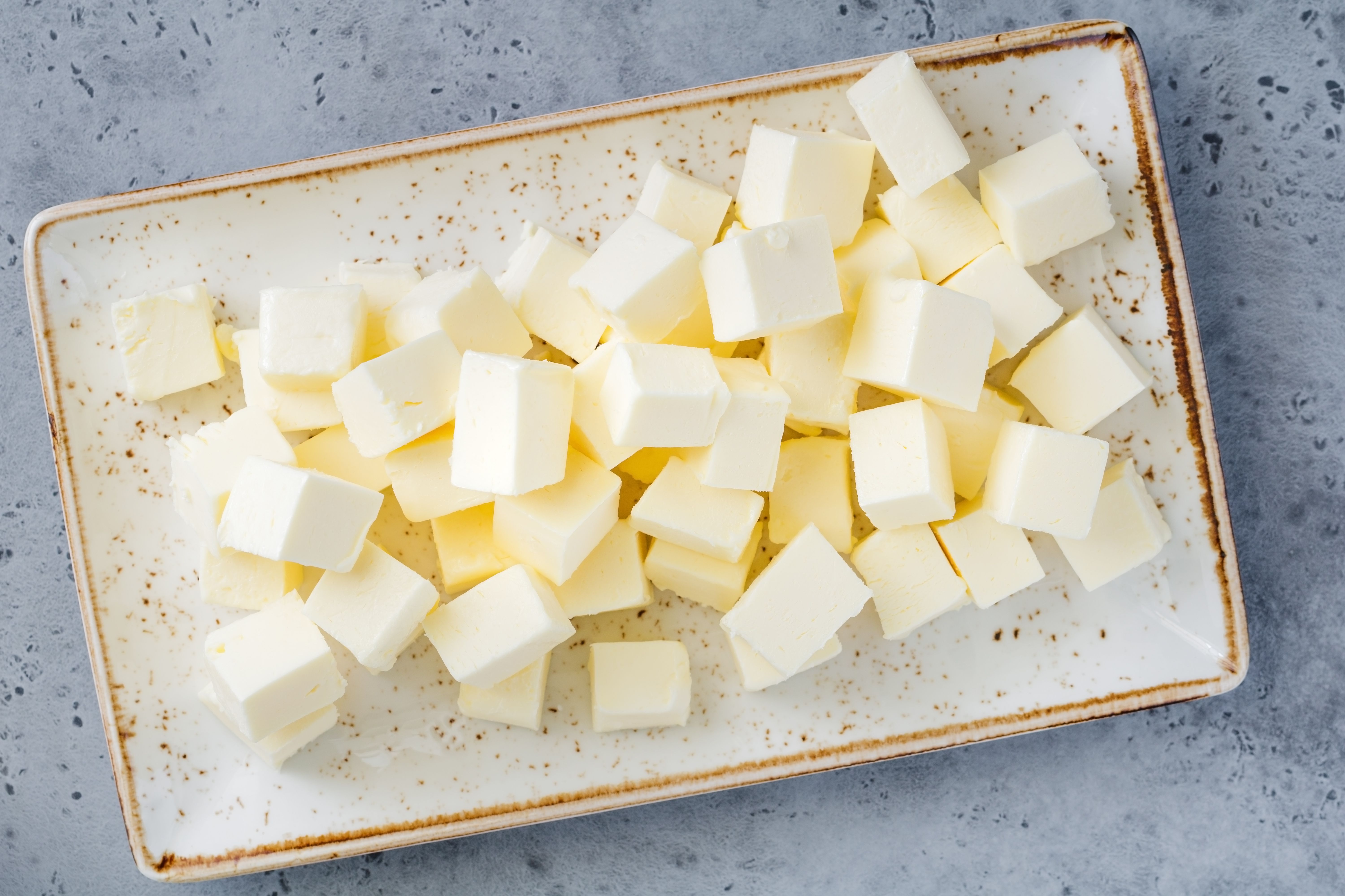 Cubed butter on a platter for beurre blanc sauce
