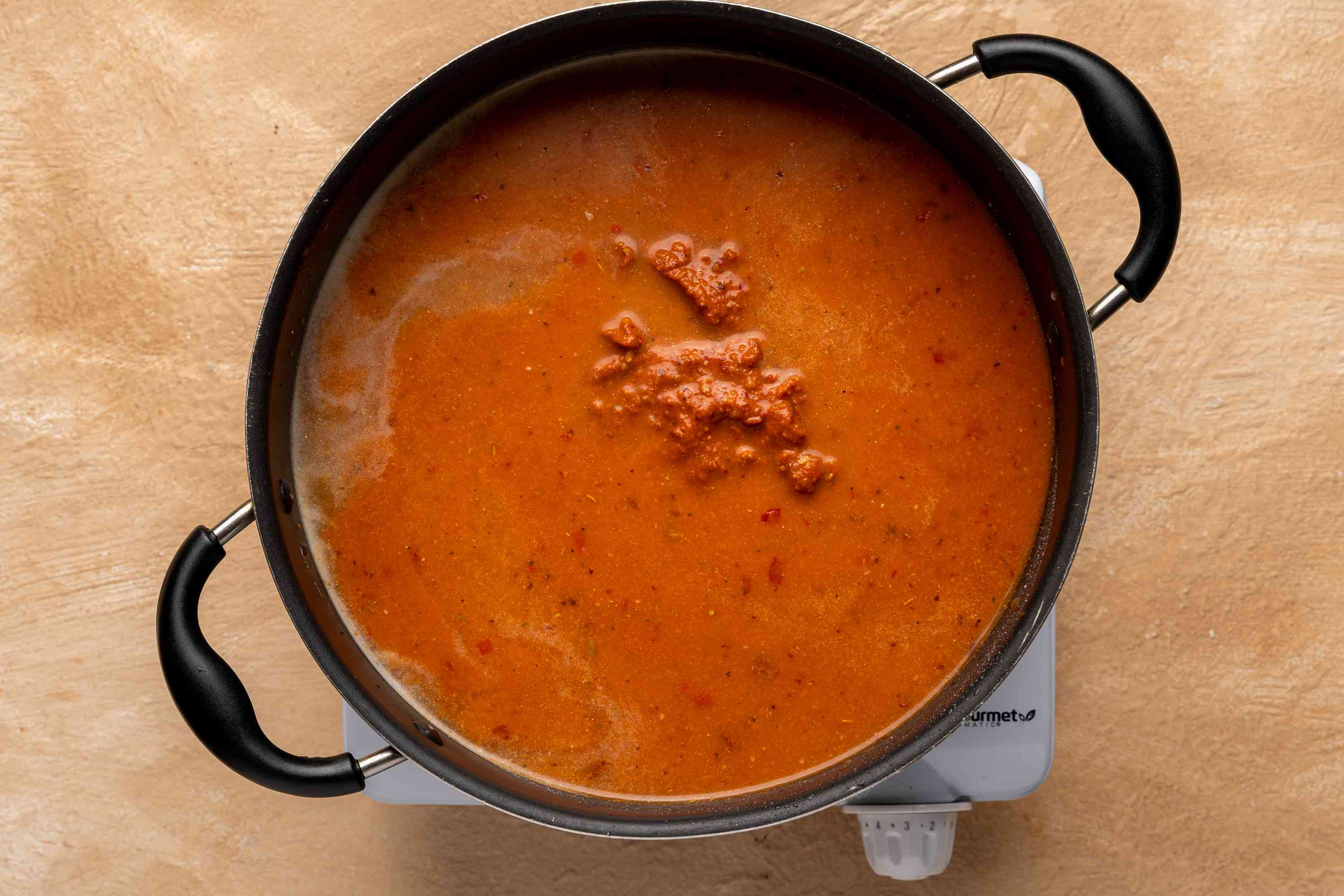 Add pureed ingredients to the pot and simmer