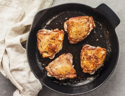Turn chicken wings over and continue cooking in skillet