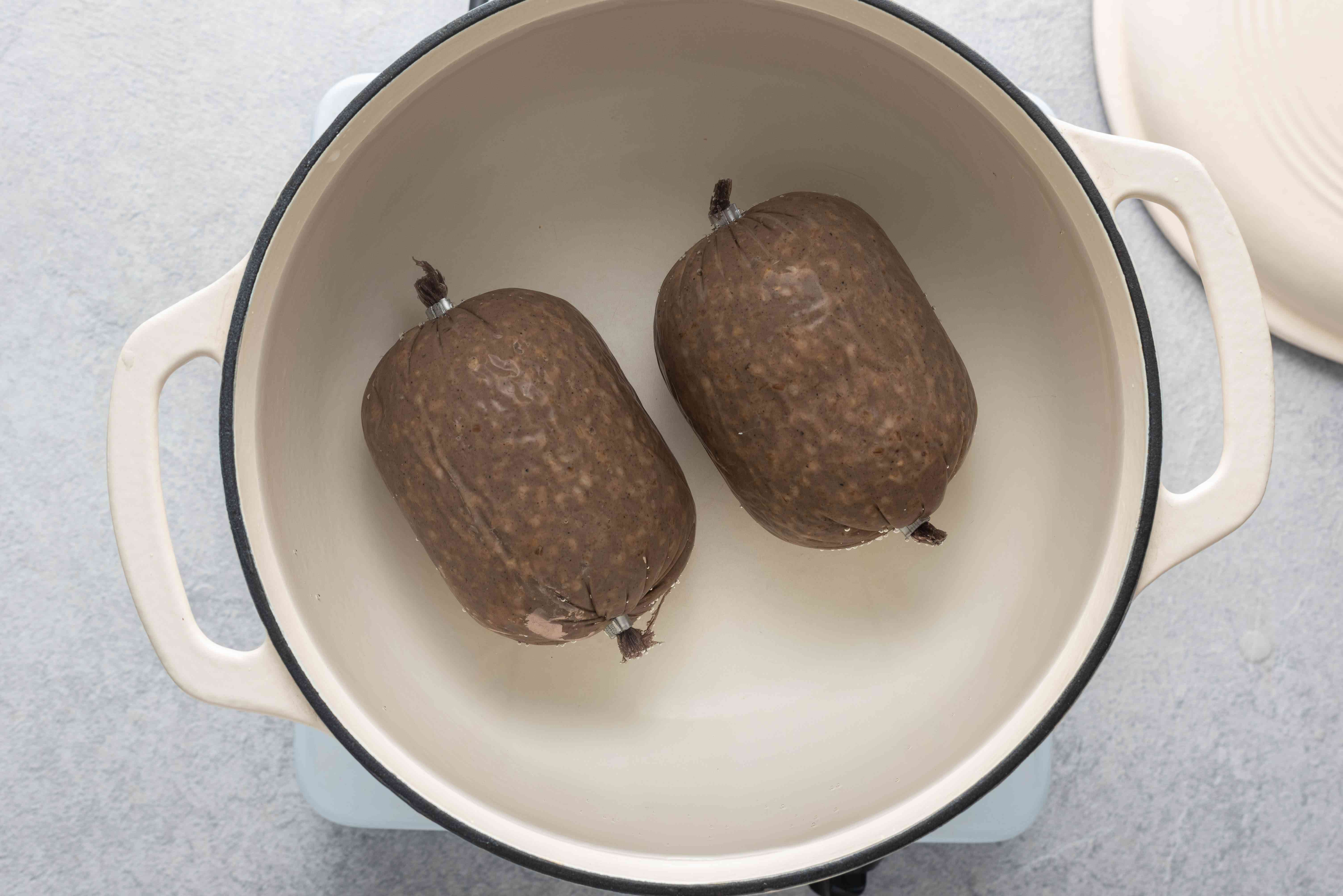 Cook the haggis by placing it in a large pot and covering it with water, bring to boil