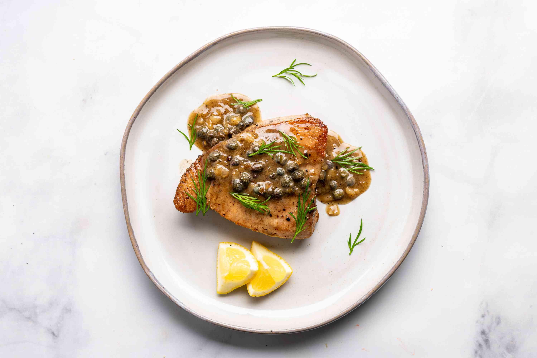 Tuna Steaks With Lemon Cream Sauce on a plate