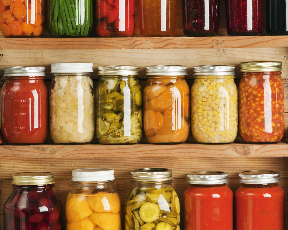 Home Canning Fruit and Vegetable Food Preserves in Storage Shelves