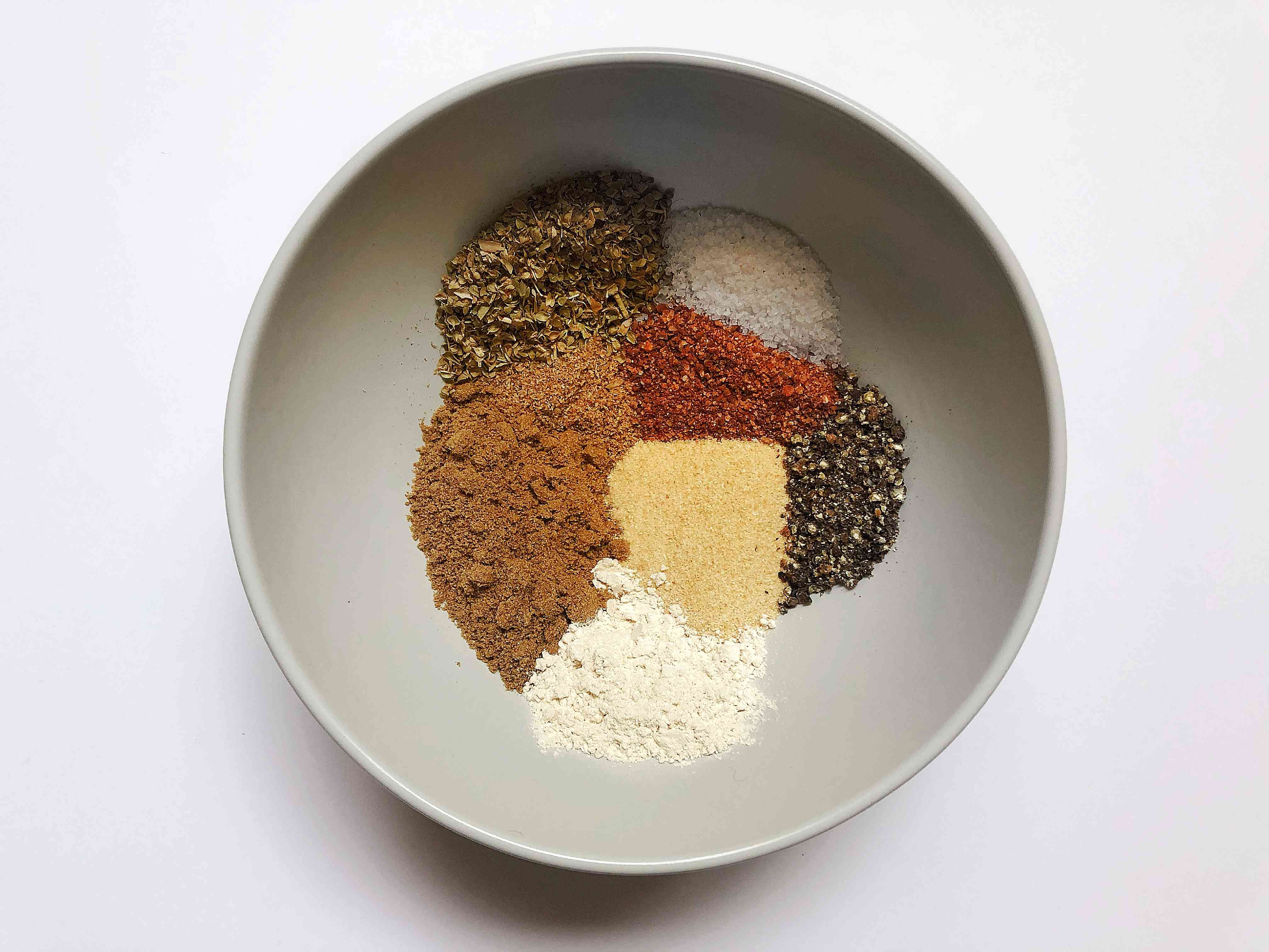 spices for homemade sazon seasoning in bowl