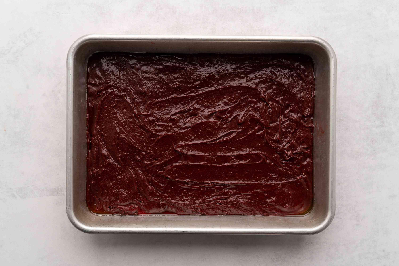 spread brownie batter in greased pan