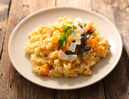 autumn risotto on plate on wooden table