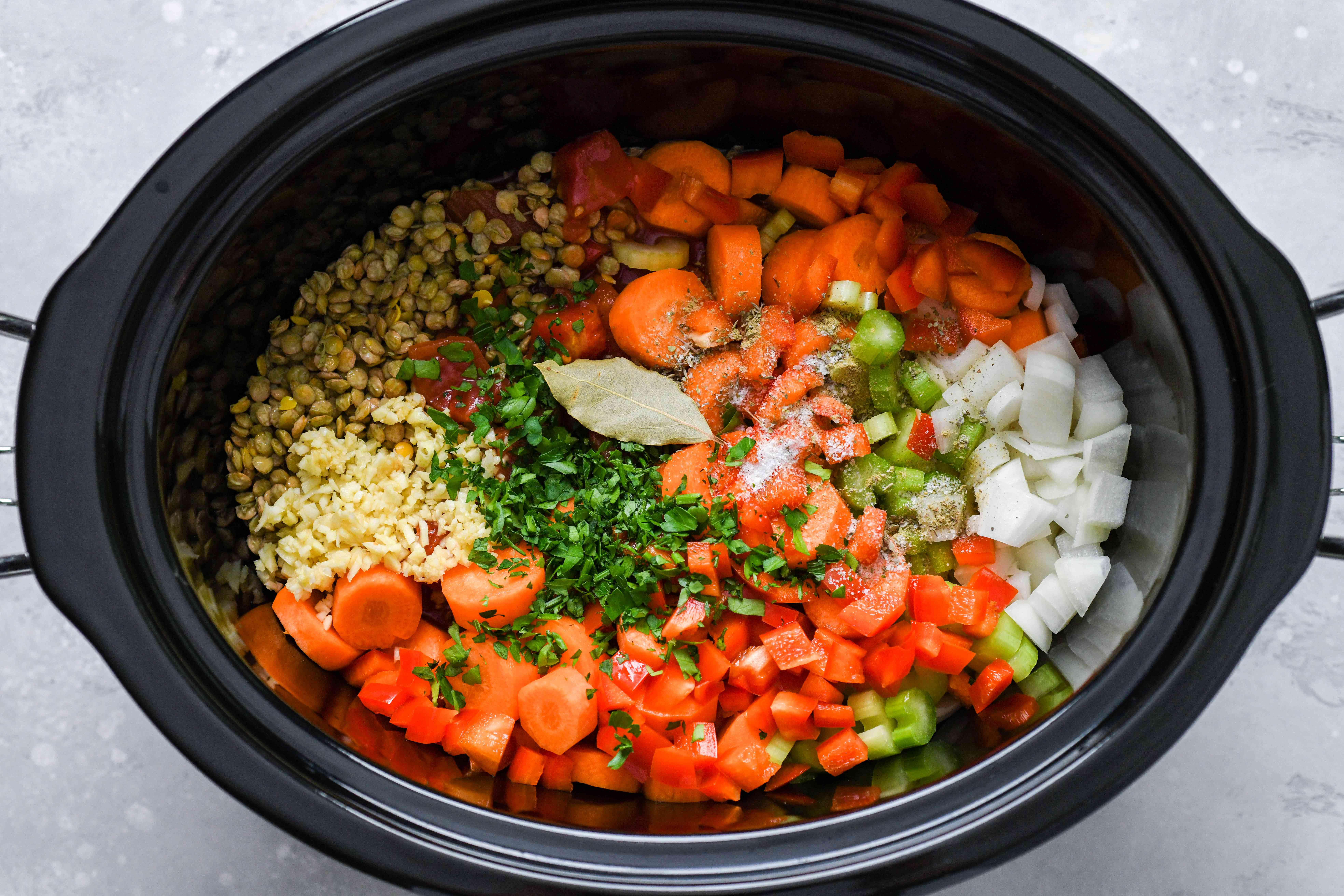Place all ingredients, except the cheese, in the slow cooker