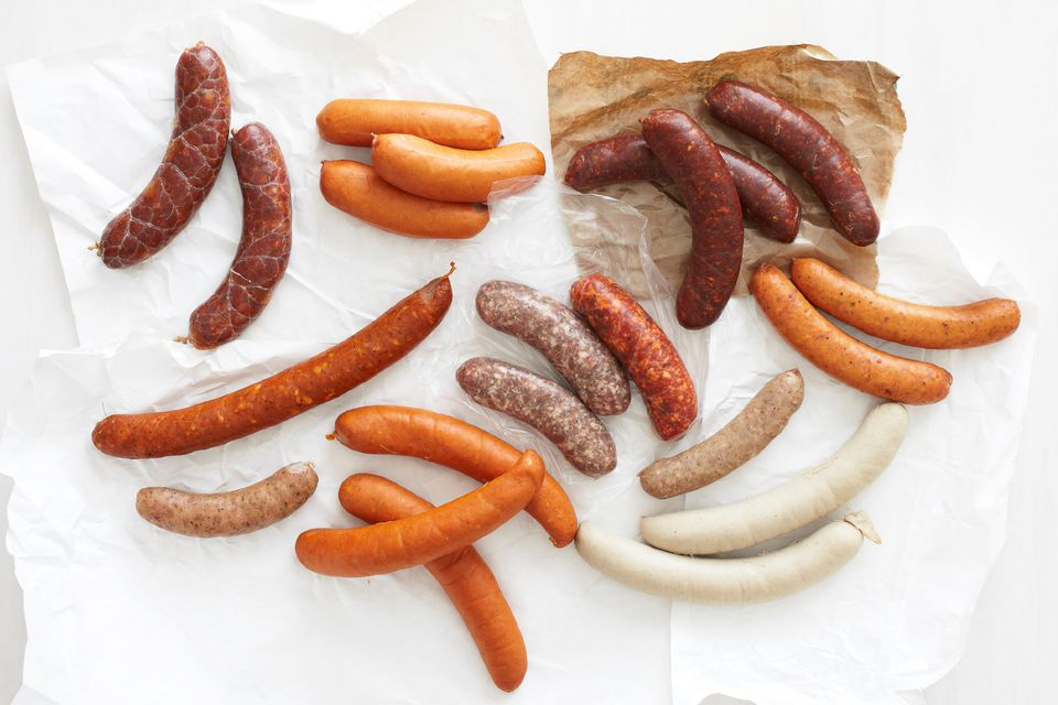 variety of sausages on butcher paper
