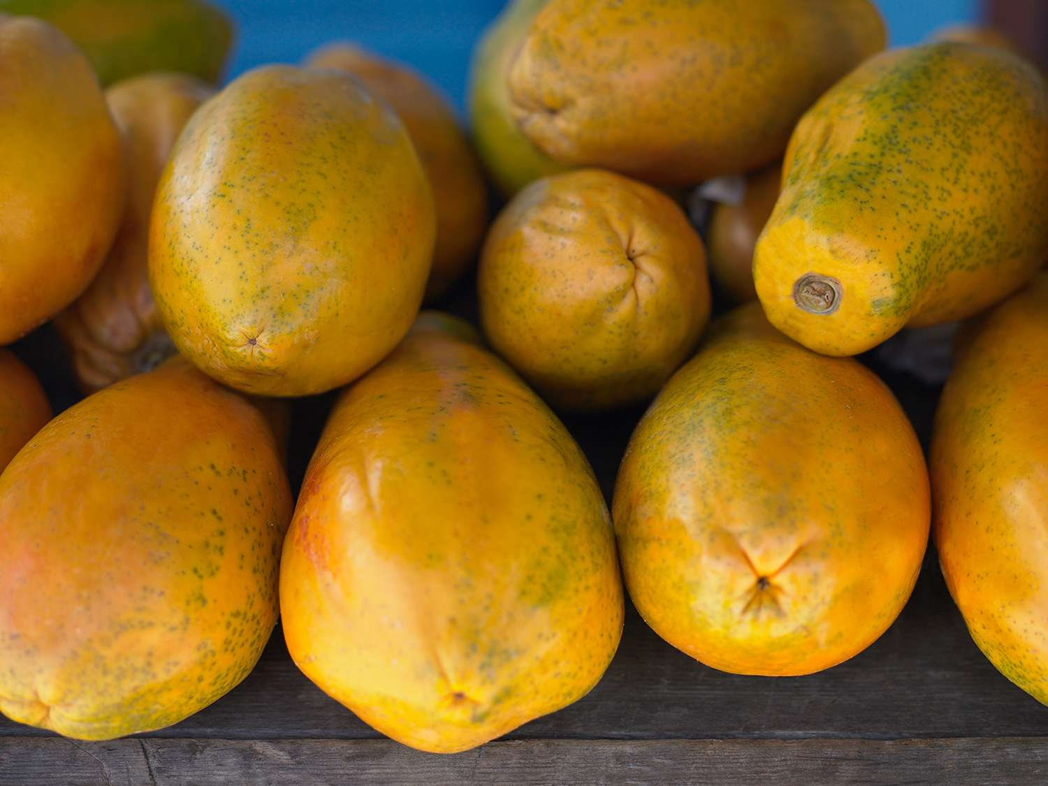 Close-up of a heap of papayas in a market
