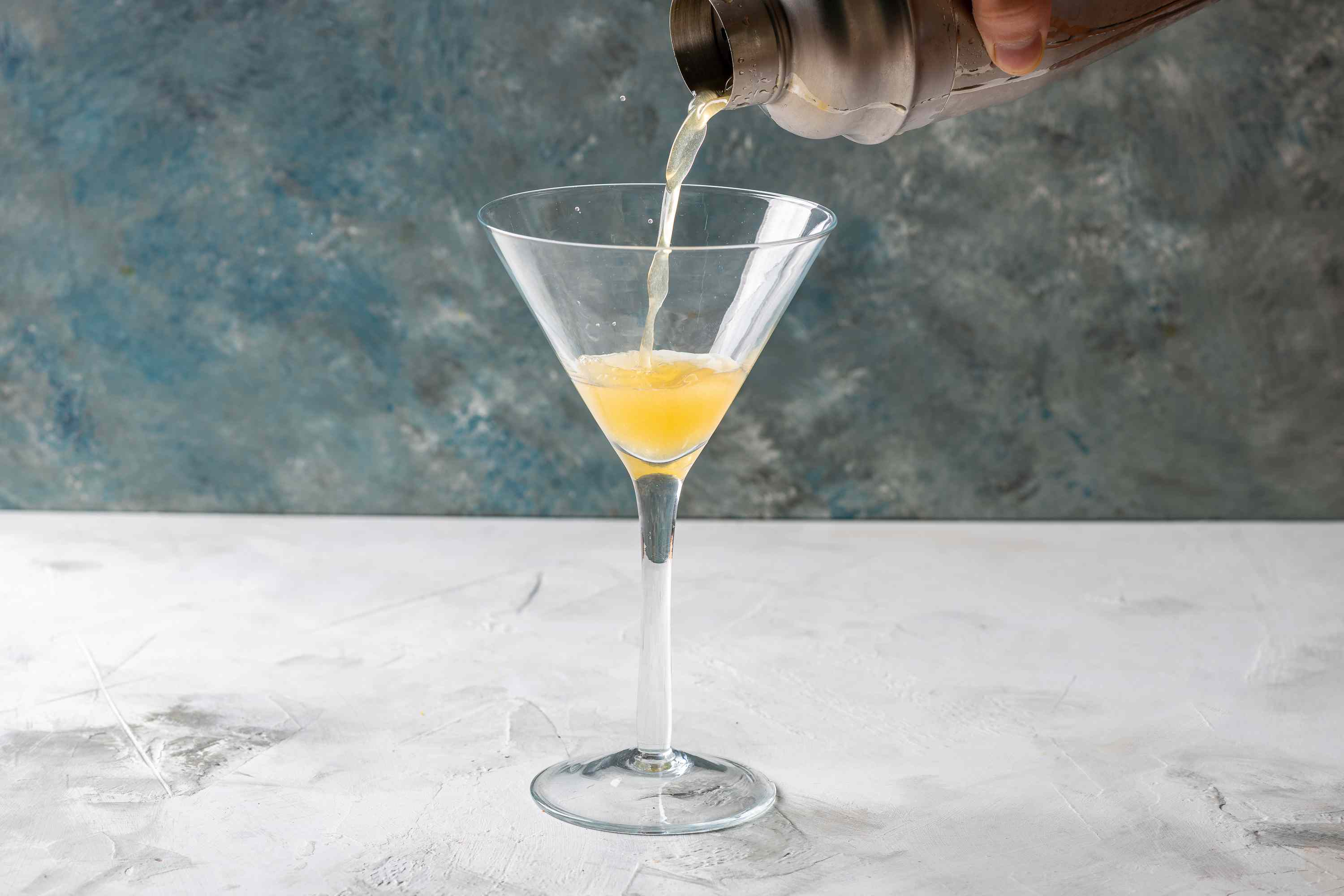 Strain the cocktail into a chilled cocktail glass