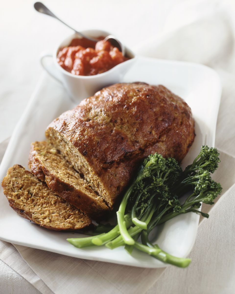 Meatloaf on a Platter with Broccoli and Tomato Sauce