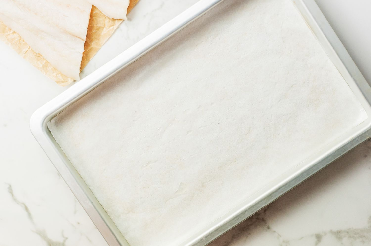 Rimmed baking sheet lined with parchment