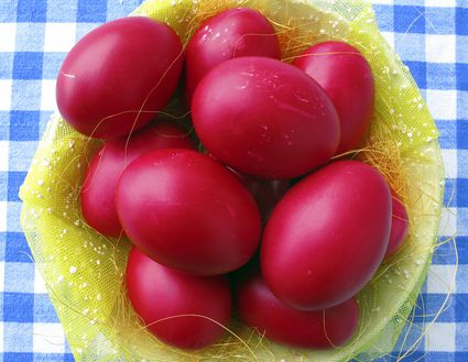 Red Easter eggs in a basket