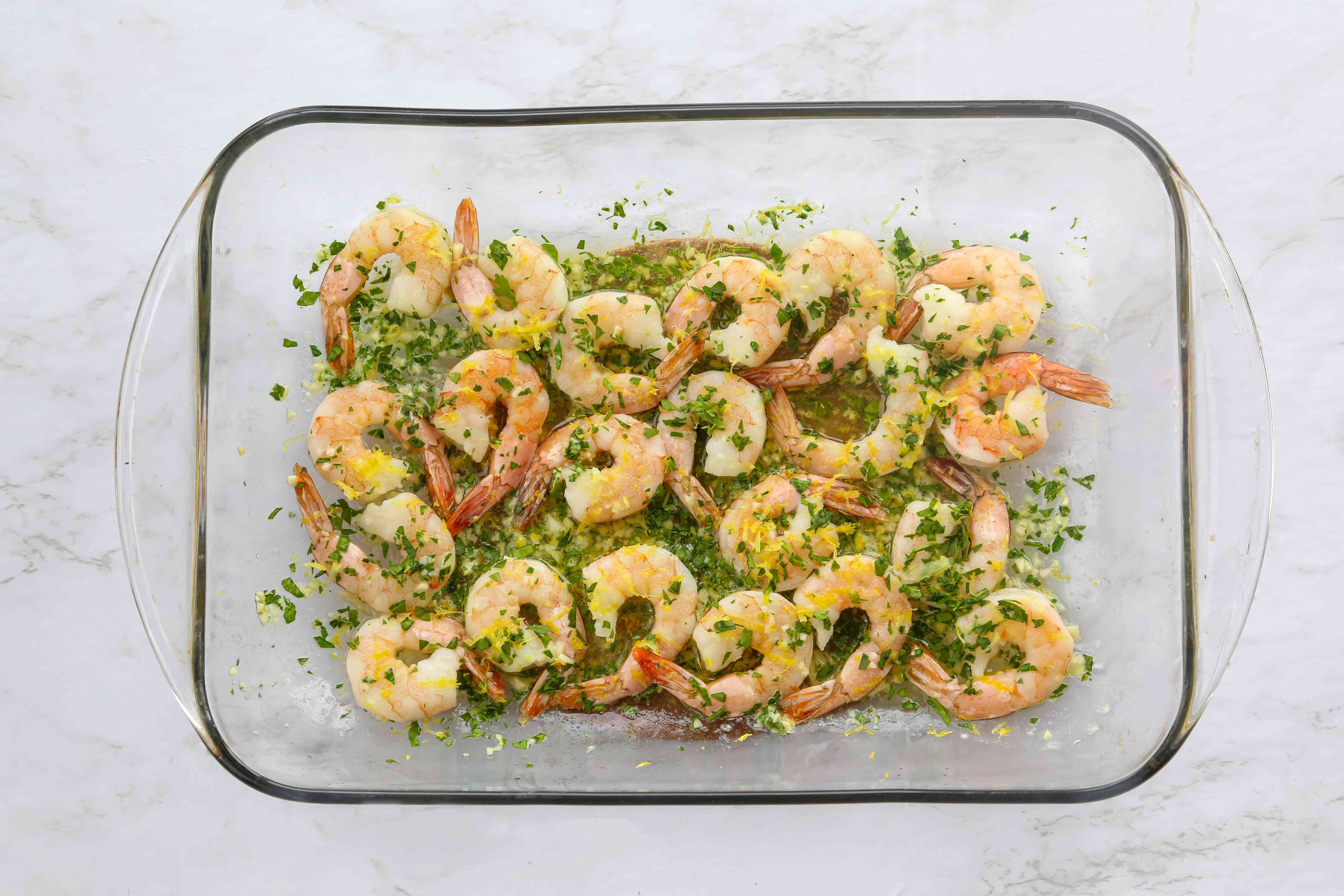 shrimp scampi cooking in a baking dish