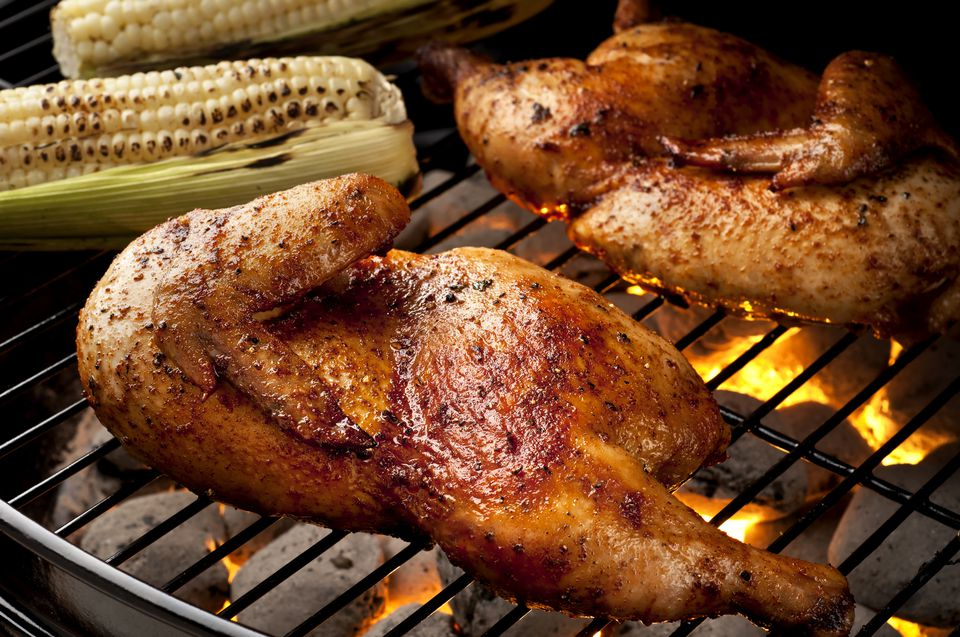 Whole chicken halves on a grill