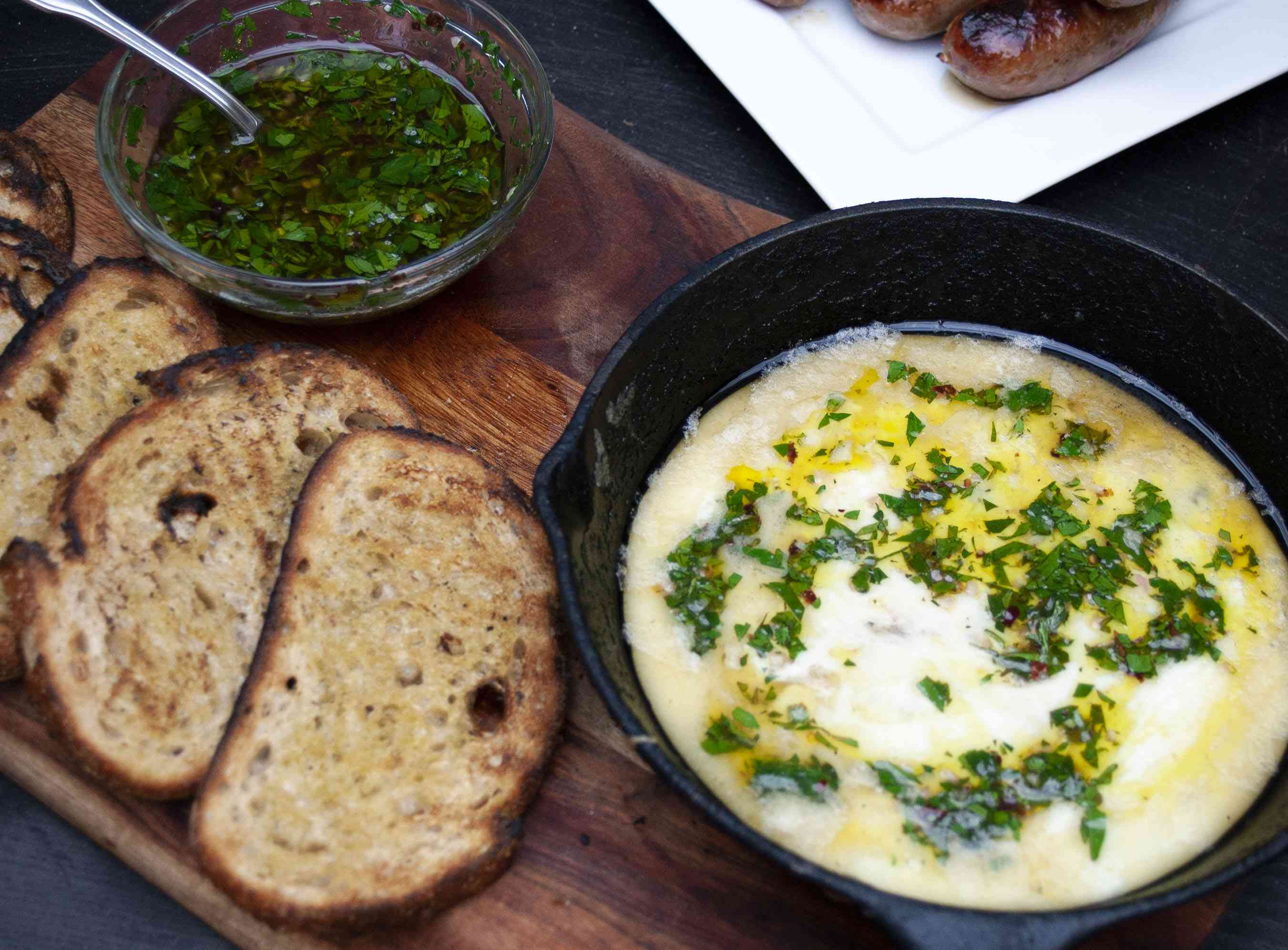 provoleta with chimichurri and grilled bread
