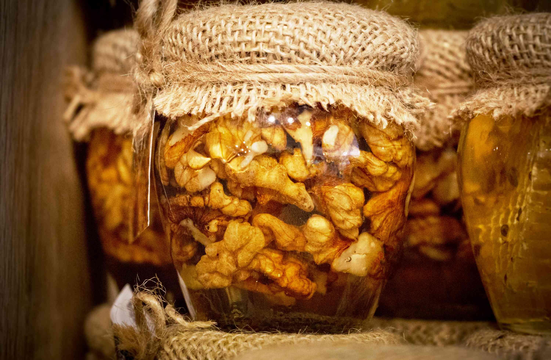 Walnuts infused in oil in glass jars