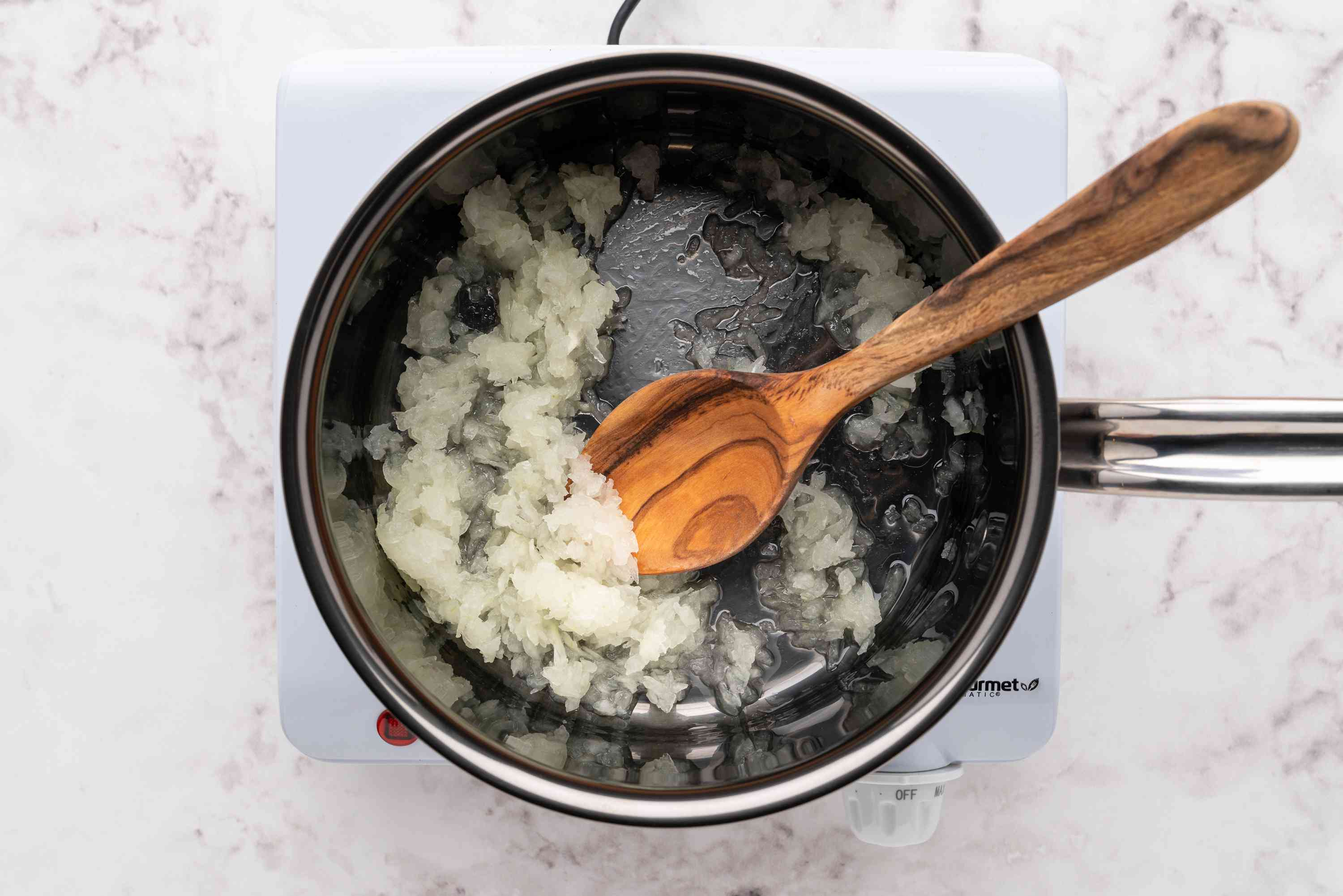 grated onions cooking in a saucepan