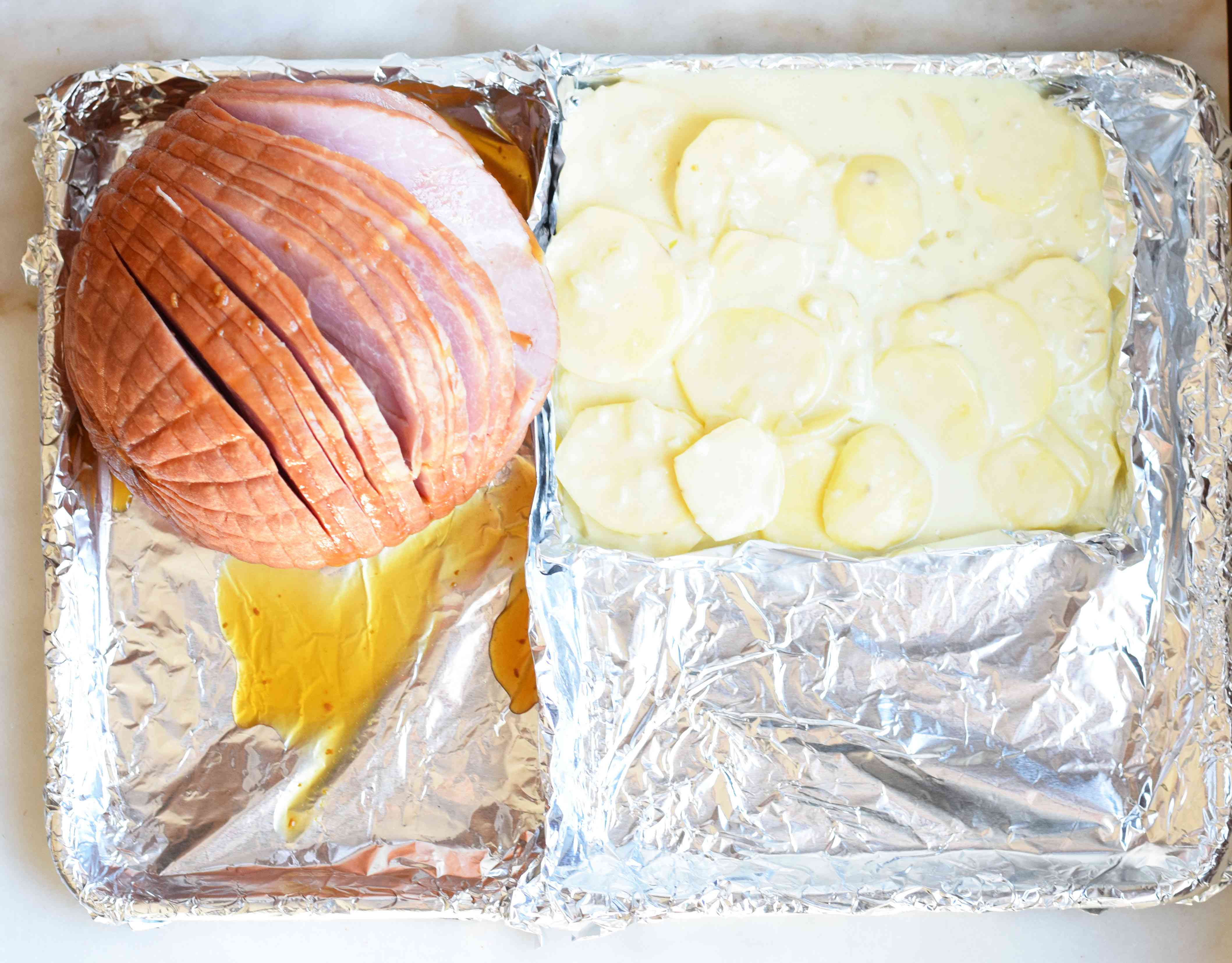 Ham and potatoes in a foil-lined sheet pan