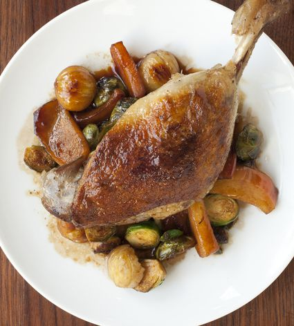 Plate of crispy duck leg with winter vegetables