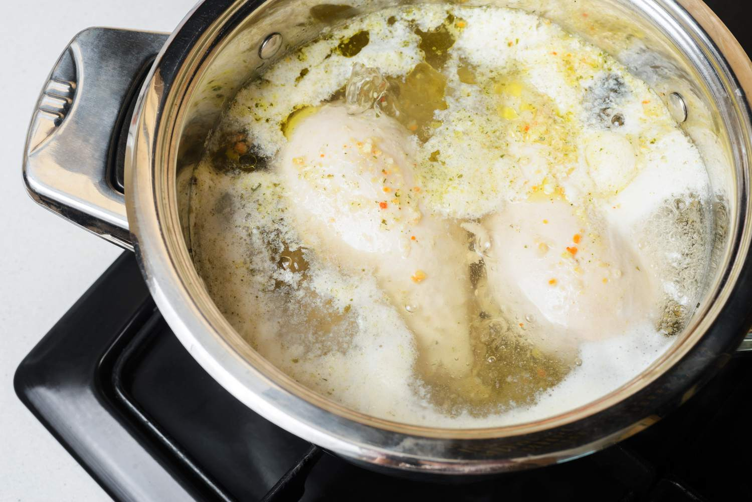 Chicken breasts boiling