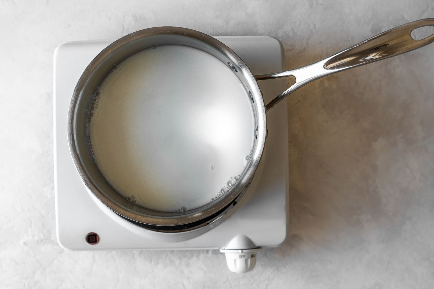 milk and water in a saucepan