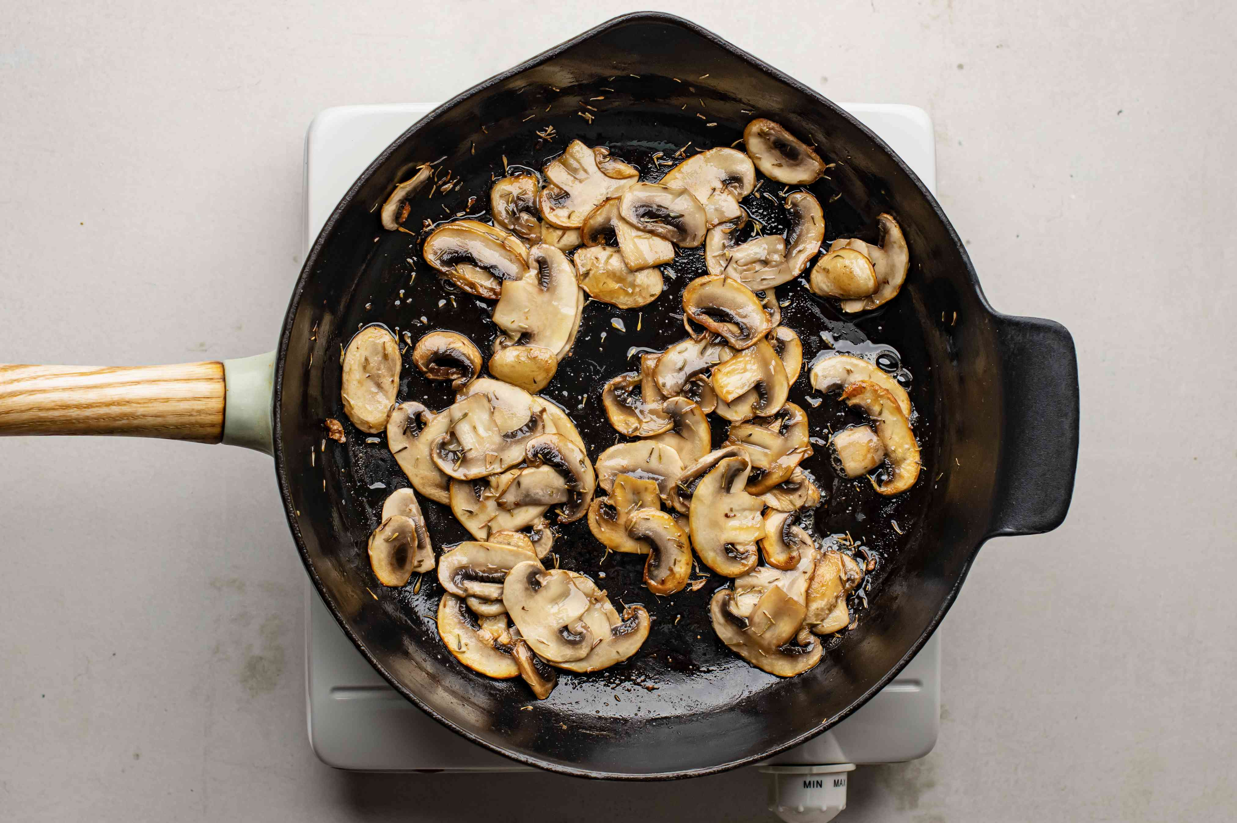 Mushrooms and butter cooking in skillet