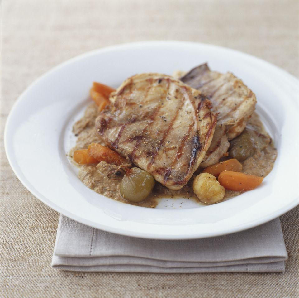 Grilled pheasant breasts on a plate with vegetables