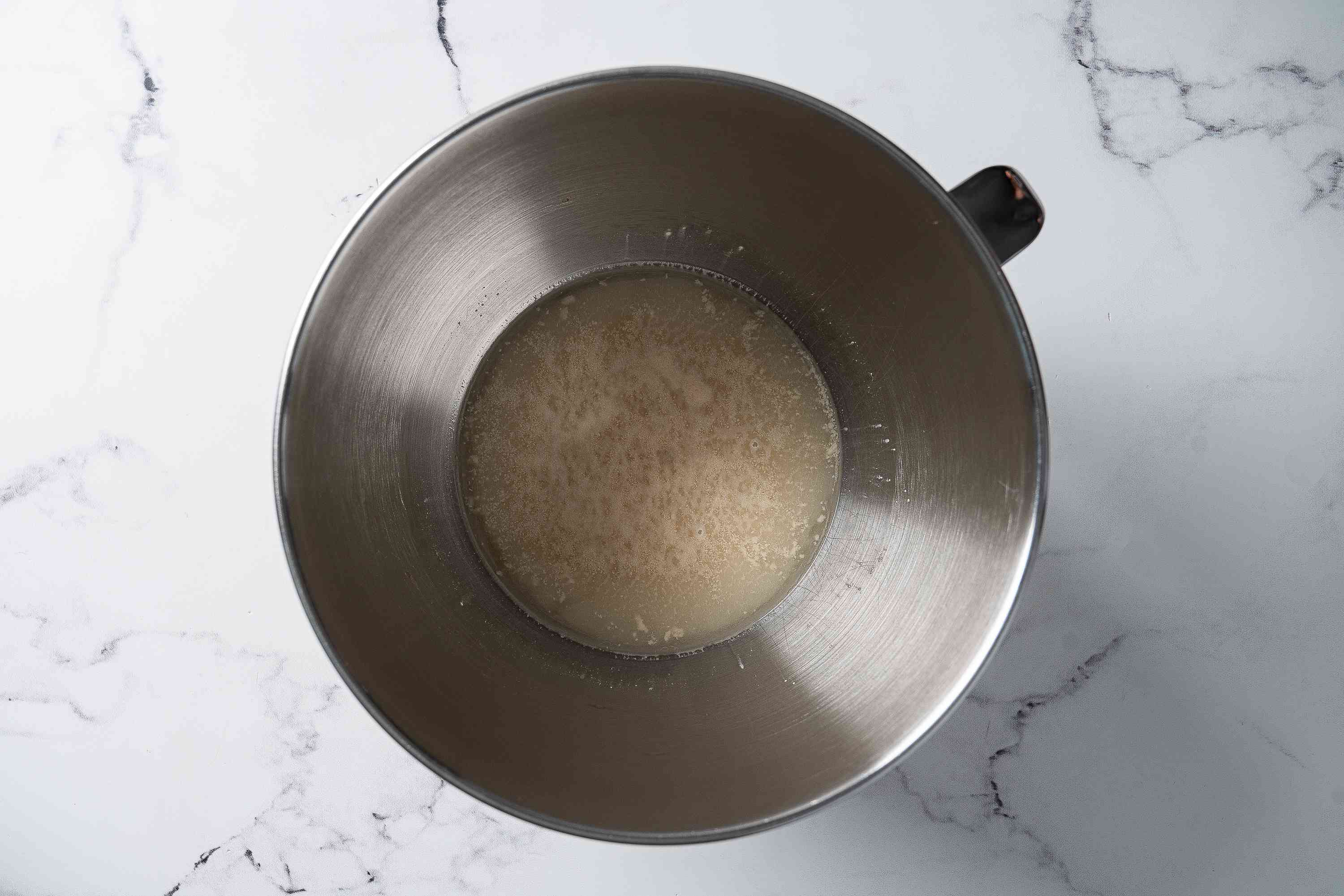 combine the warm water, yeast, and sugar
